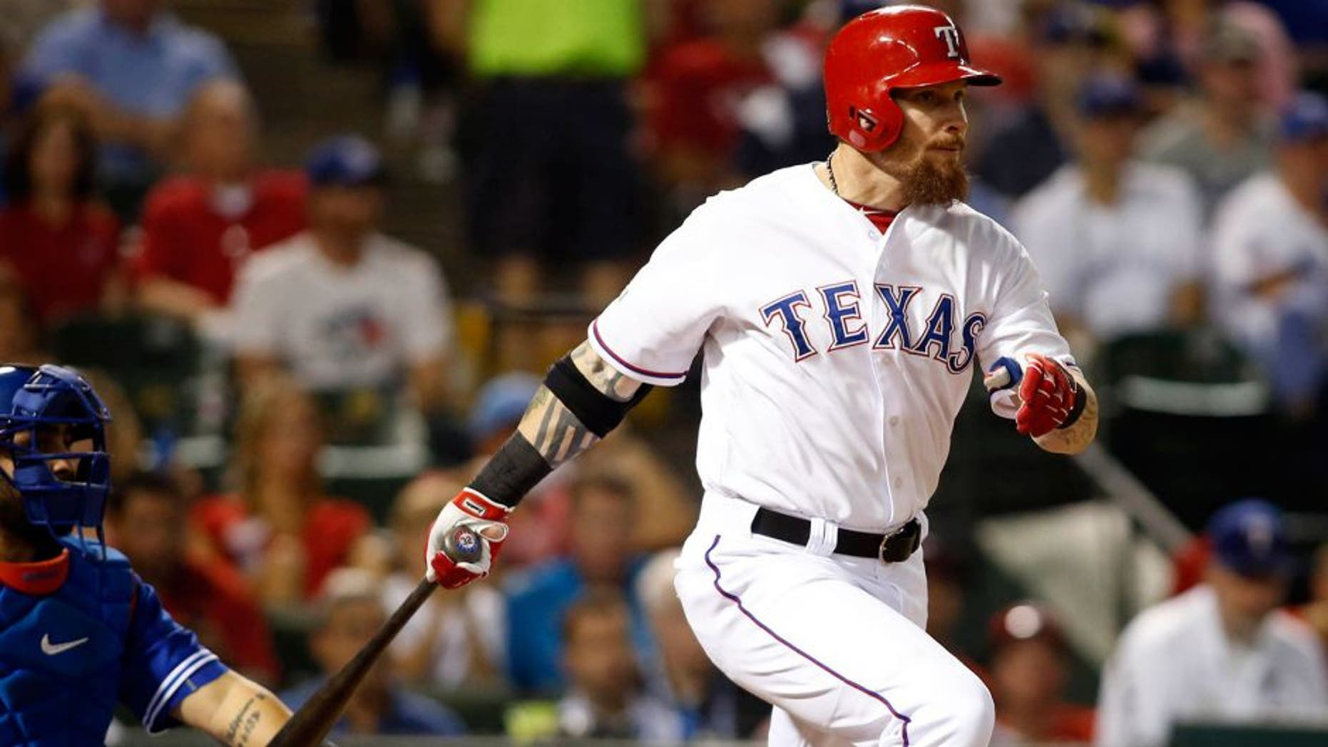 Oct 11, 2015; Arlington, TX, USA; Texas Rangers left fielder Josh Hamilton hits a single against the Toronto Blue Jays in the fifth inning in game three of the ALDS at Globe Life Park in Arlington. Mandatory Credit: Tim Heitman-USA TODAY Sports