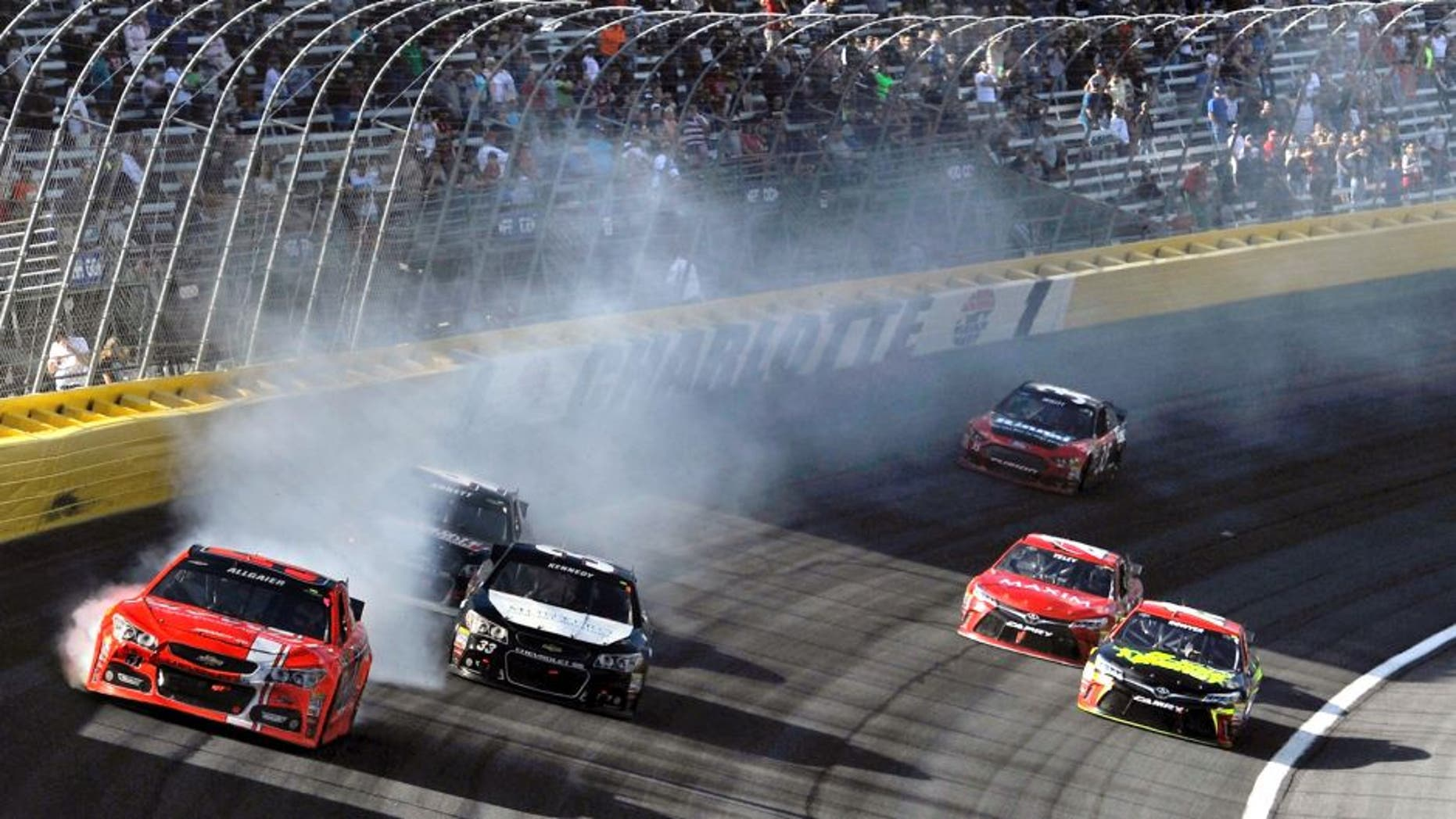 CHARLOTTE, NC - OCTOBER 11: Justin Allgaier, driver of the #51 Brandt Chevrolet, is involved in an on-track incident during the NASCAR Sprint Cup Series Bank of America 500 at Charlotte Motor Speedway on October 11, 2015 in Charlotte, North Carolina. (Photo by Jared C. Tilton/NASCAR via Getty Images)