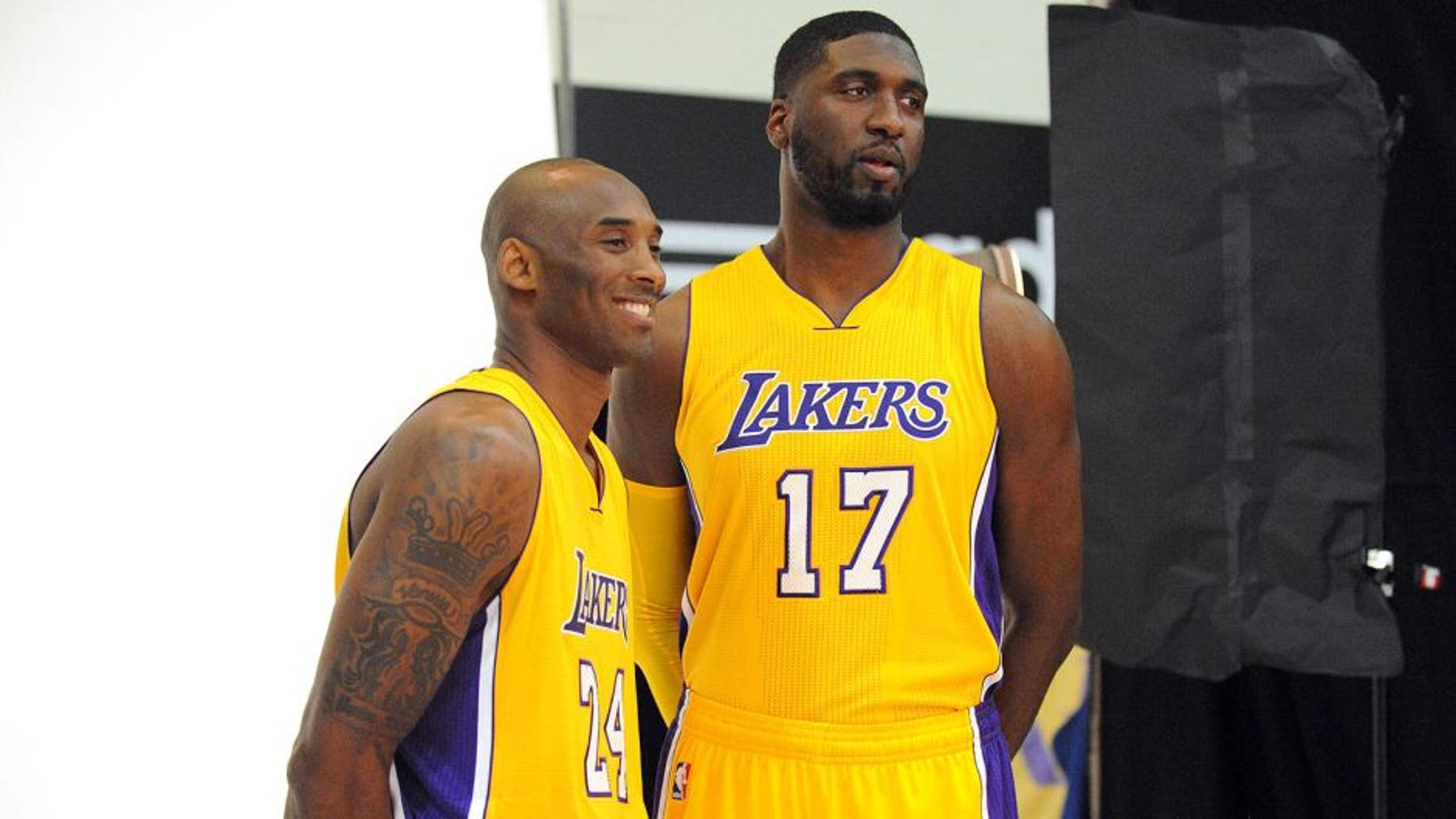 September 28, 2015; El Segundo, CA, USA; Los Angeles Lakers guard Kobe Bryant (left) and center Roy Hibbert pose for photographs during media day at Toyota Sports Center. Mandatory Credit: Gary A. Vasquez-USA TODAY Sports