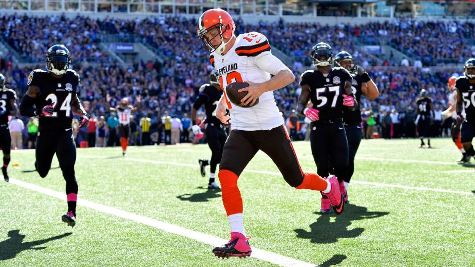 Oct 11, 2015; Baltimore, MD, USA; Cleveland Browns quarterback Josh McCown (13) scores a touchdown during the third quarter against the Baltimore Ravens at M&T Bank Stadium. Mandatory Credit: Tommy Gilligan-USA TODAY Sports