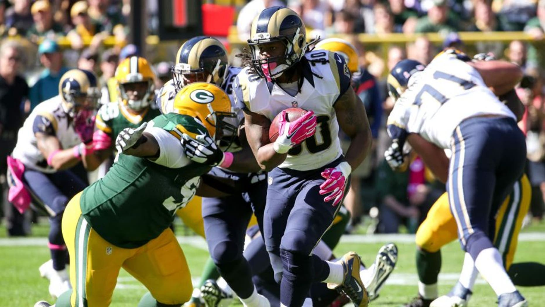 GREEN BAY, WI - OCTOBER 11: Todd Gurley #30 of the St. Louis Rams carries the football against the Green Bay Packers in the second quarter at Lambeau Field on October 11, 2015 in Green Bay, Wisconsin. (Photo by Jonathan Daniel/Getty Images)