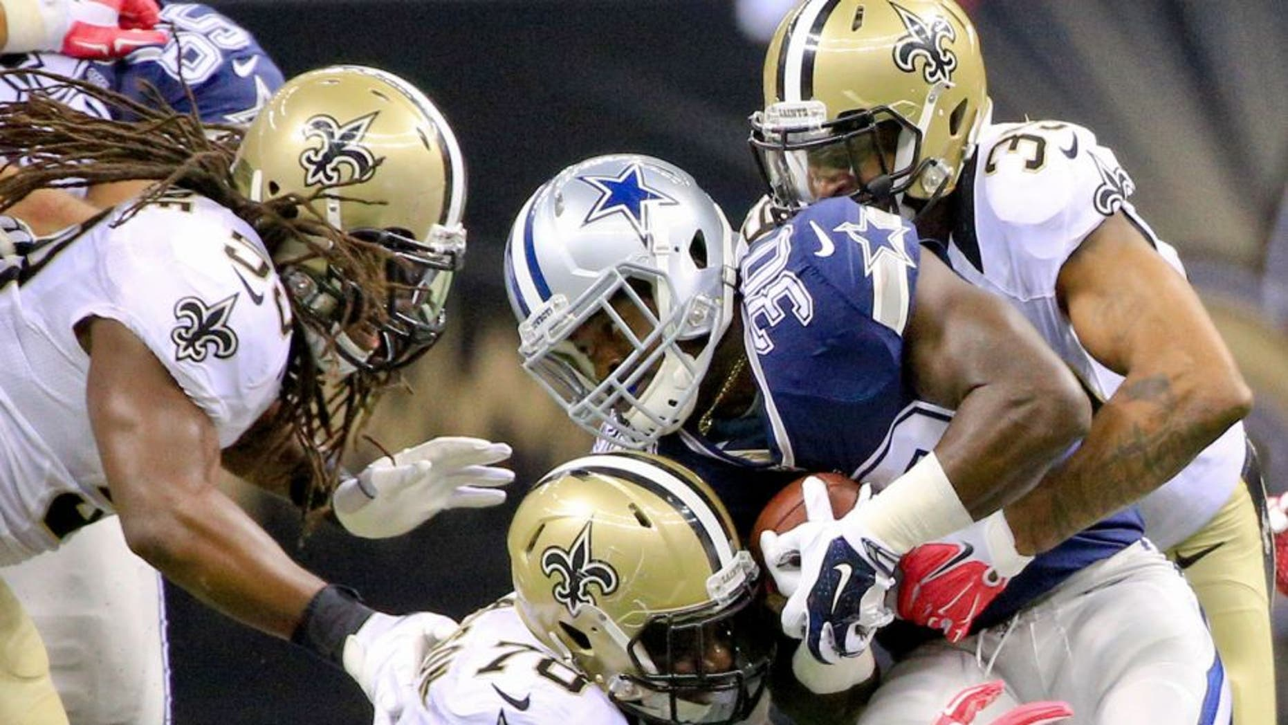 Oct 4, 2015; New Orleans, LA, USA; New Orleans Saints cornerback Brandon Browner (39) and defensive end Bobby Richardson (78) tackle Dallas Cowboys running back Christine Michael (30) during the fourth quarter at the Mercedes-Benz Superdome. The Saints won 26-20 in overtime. Mandatory Credit: Derick E. Hingle-USA TODAY Sports