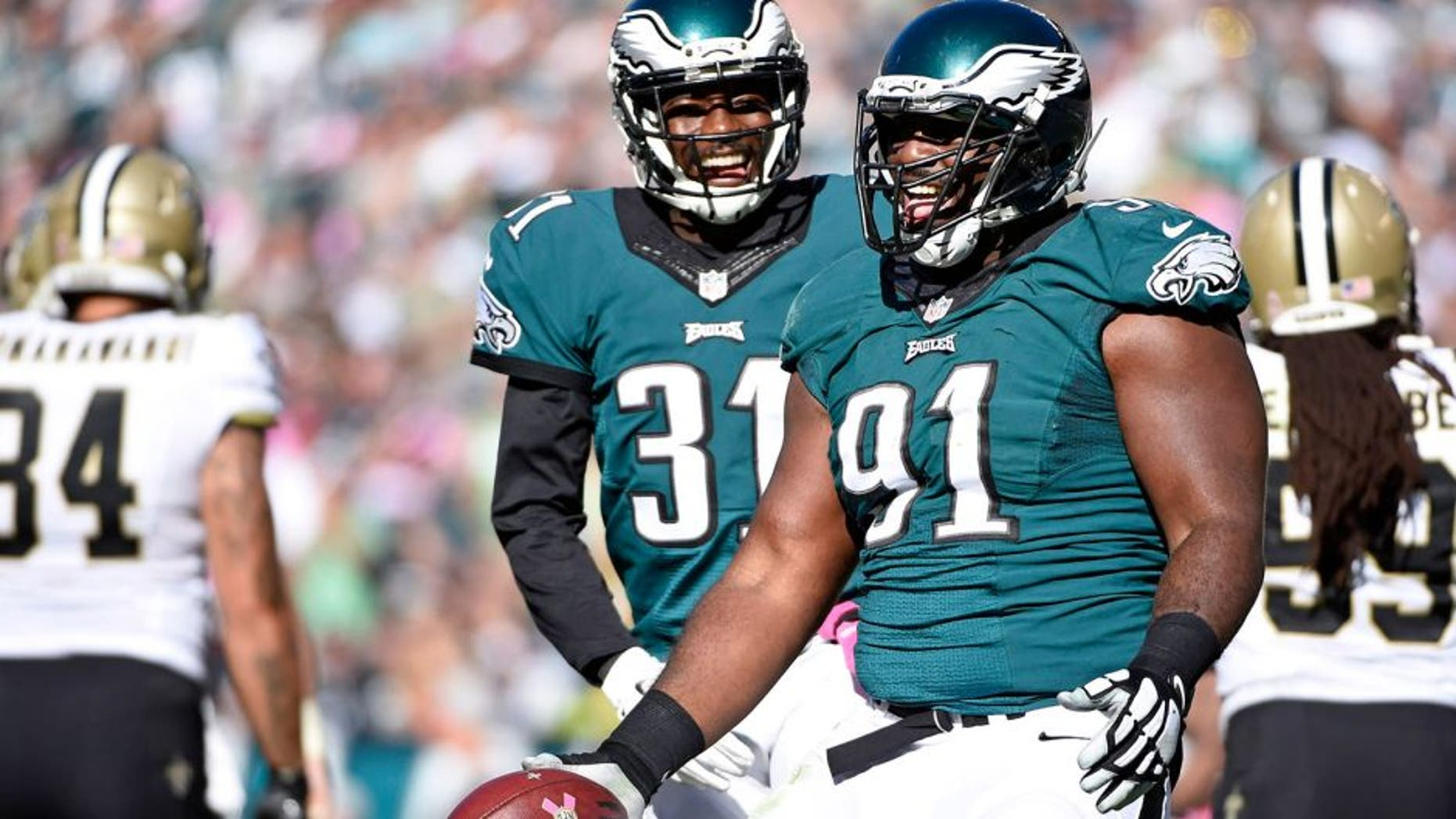 Oct 11, 2015; Philadelphia, PA, USA; Philadelphia Eagles defensive end Fletcher Cox (91) celebrates after recovering a fumble against the New Orleans Saints at Lincoln Financial Field. Mandatory Credit: Eric Hartline-USA TODAY Sports