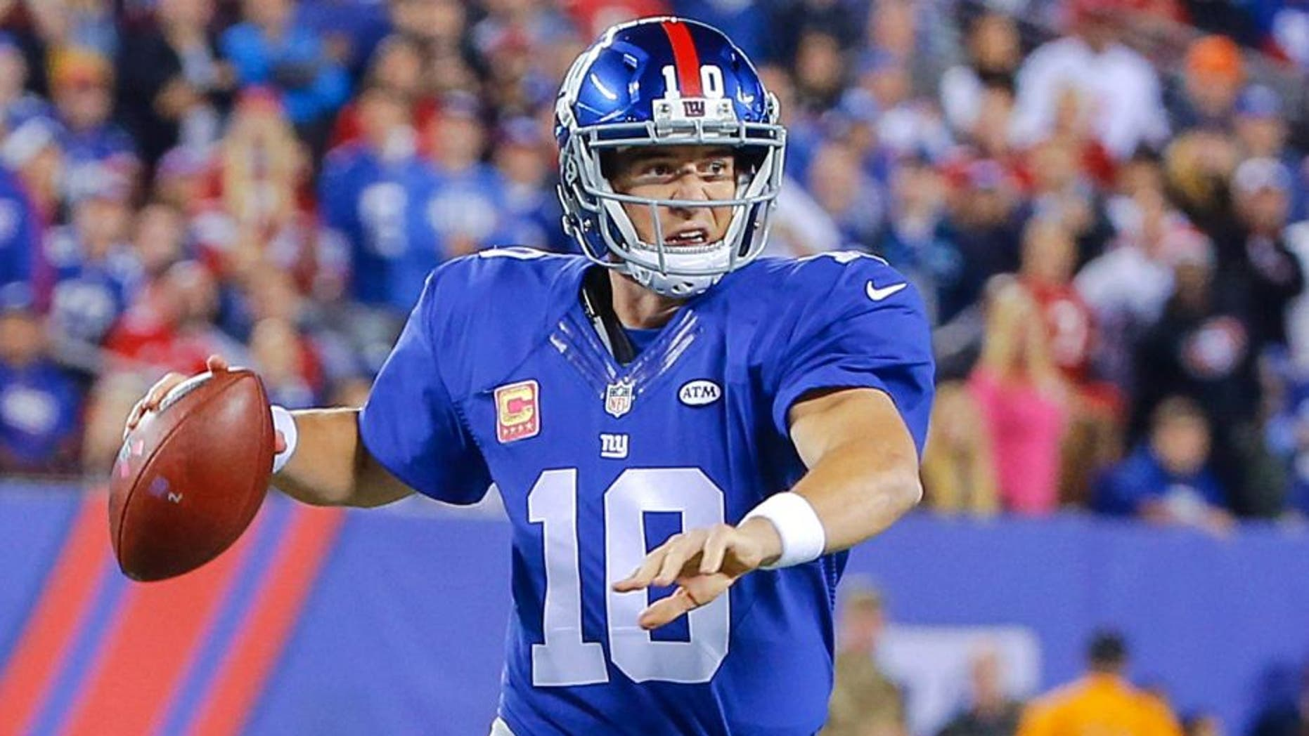 Oct 11, 2015; East Rutherford, NJ, USA; New York Giants quarterback Eli Manning (10) prepares to throw the ball during the first quarter against the San Francisco 49ers at MetLife Stadium. Mandatory Credit: Jim O'Connor-USA TODAY Sports