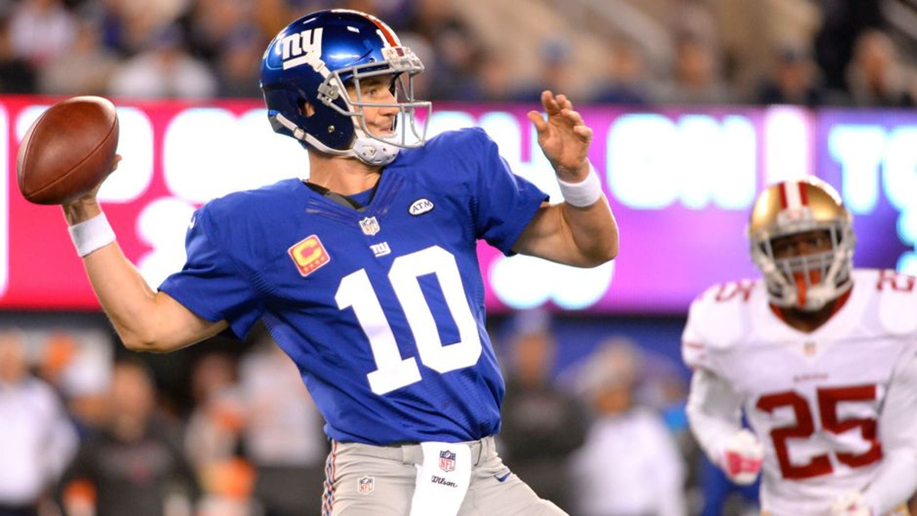 Oct 11, 2015; East Rutherford, NJ, USA; New York Giants quarterback Eli Manning (10) throws the ball in the first quarter against the San Francisco 49ers at MetLife Stadium. Mandatory Credit: Robert Deutsch-USA TODAY Sports