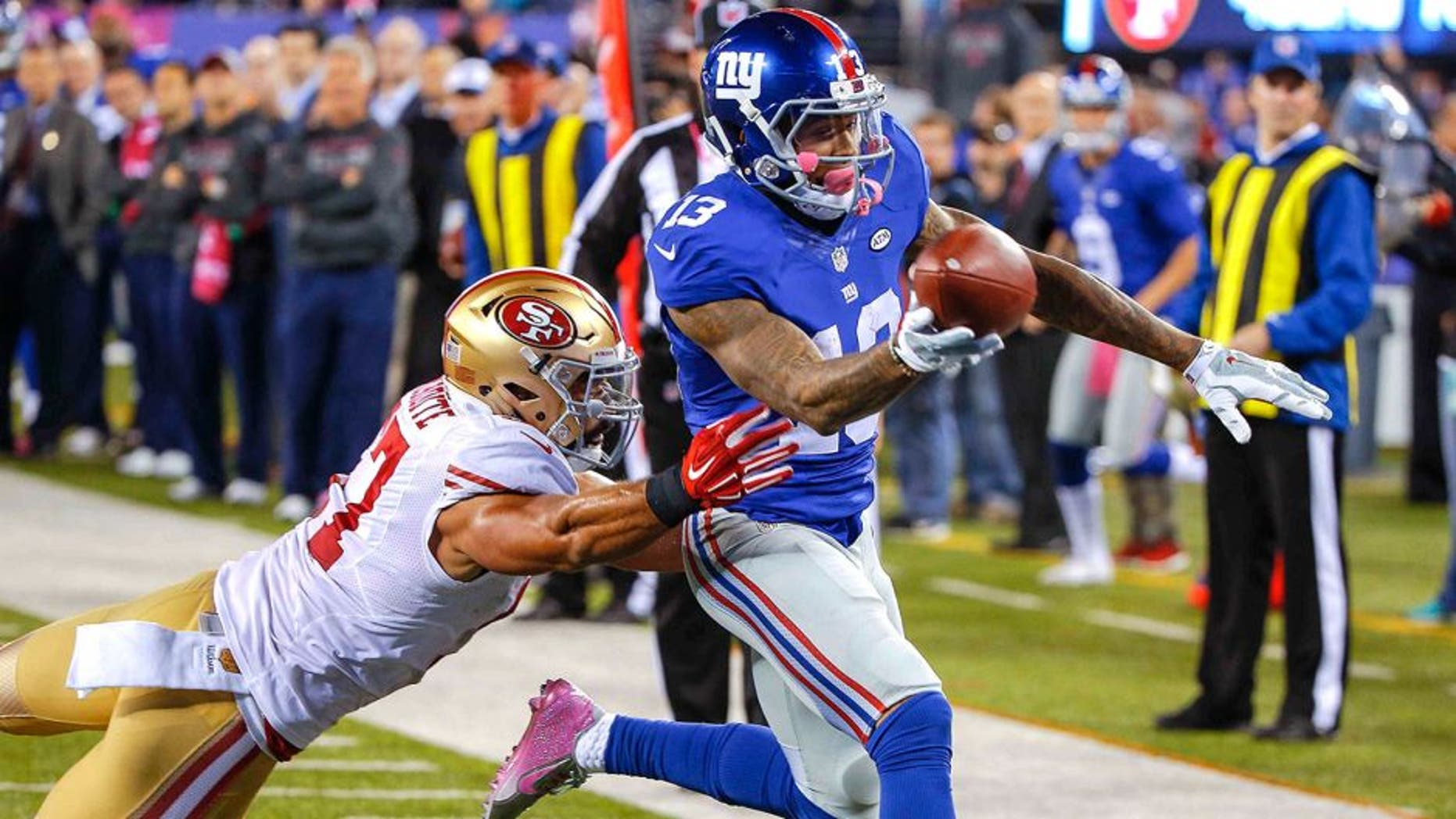 Oct 11, 2015; East Rutherford, NJ, USA; New York Giants wide receiver Odell Beckham (13) scores a touchdown against the San Francisco 49ers during the third quarter at MetLife Stadium. The Giants won 30-27. Mandatory Credit: Jim O'Connor-USA TODAY Sports