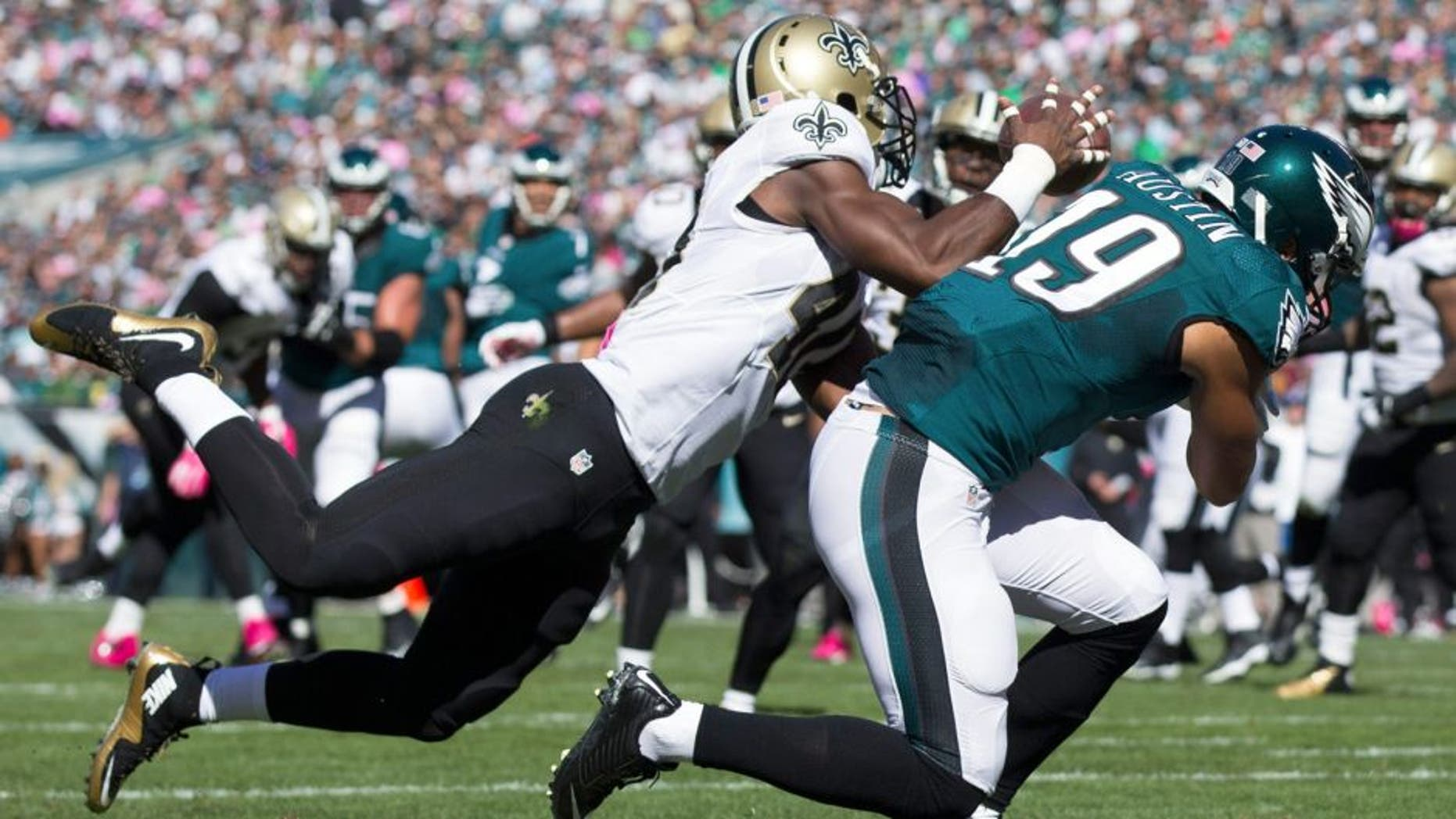 Oct 11, 2015; Philadelphia, PA, USA; New Orleans Saints cornerback Delvin Breaux (40) intercepts a pass intended for Philadelphia Eagles wide receiver Miles Austin (19) during the second quarter at Lincoln Financial Field. Mandatory Credit: Bill Streicher-USA TODAY Sports