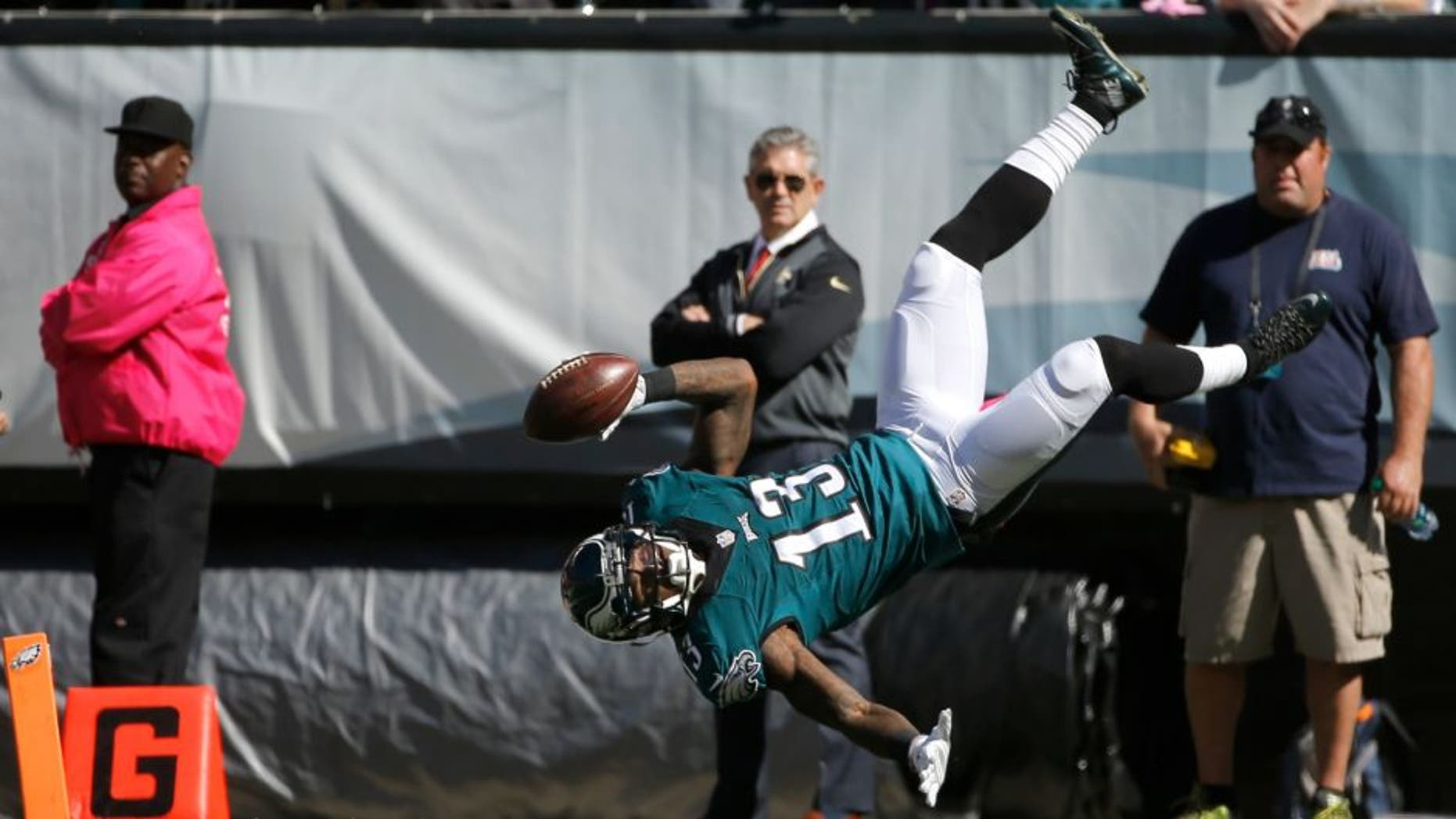 Philadelphia Eagles' Josh Huff flips into the end zone for a touchdown during the first half of an NFL football game against the New Orleans Saints, Sunday, Oct. 11, 2015, in Philadelphia. (AP Photo/Michael Perez)