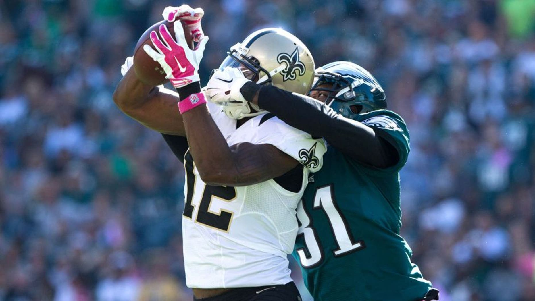 Oct 11, 2015; Philadelphia, PA, USA; New Orleans Saints wide receiver Marques Colston (12) makes a catch against the defense of Philadelphia Eagles cornerback Byron Maxwell (31) during the third quarter at Lincoln Financial Field. Mandatory Credit: Bill Streicher-USA TODAY Sports