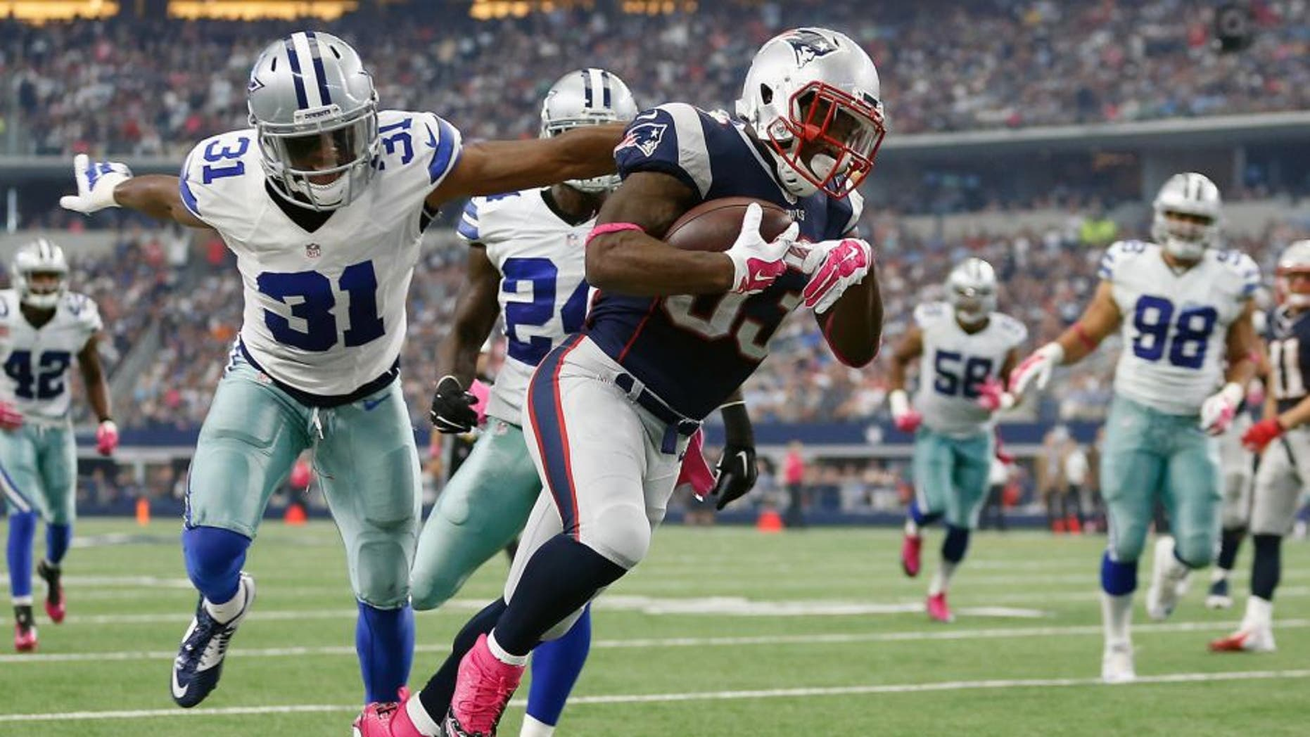 ARLINGTON, TX - OCTOBER 11: Running back Dion Lewis #33 of the New England Patriots carries the ball as cornerback Byron Jones #31 of the Dallas Cowboys tries to make the tackle during the first half of the NFL game at AT&T Stadium on October 11, 2015 in Arlington, Texas. (Photo by Christian Petersen/Getty Images)