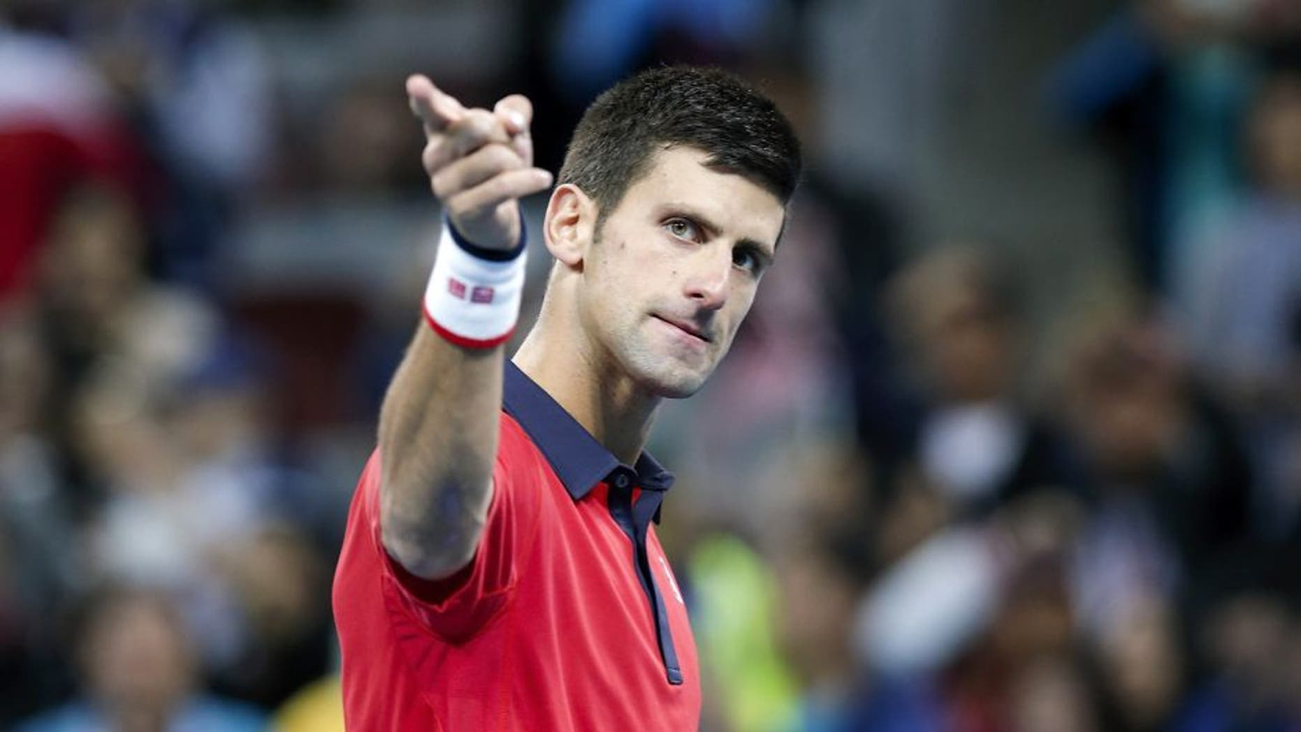 BEIJING, CHINA - OCTOBER 11: Novak Djokovic of Serbia celebrates after winning the Men's Single Final match against Rafael Nadal of Spain on day 9 of the 2015 China Open at the China National Tennis Centre on October 11, 2015 in Beijing, China. (Photo by Lintao Zhang/Getty Images)
