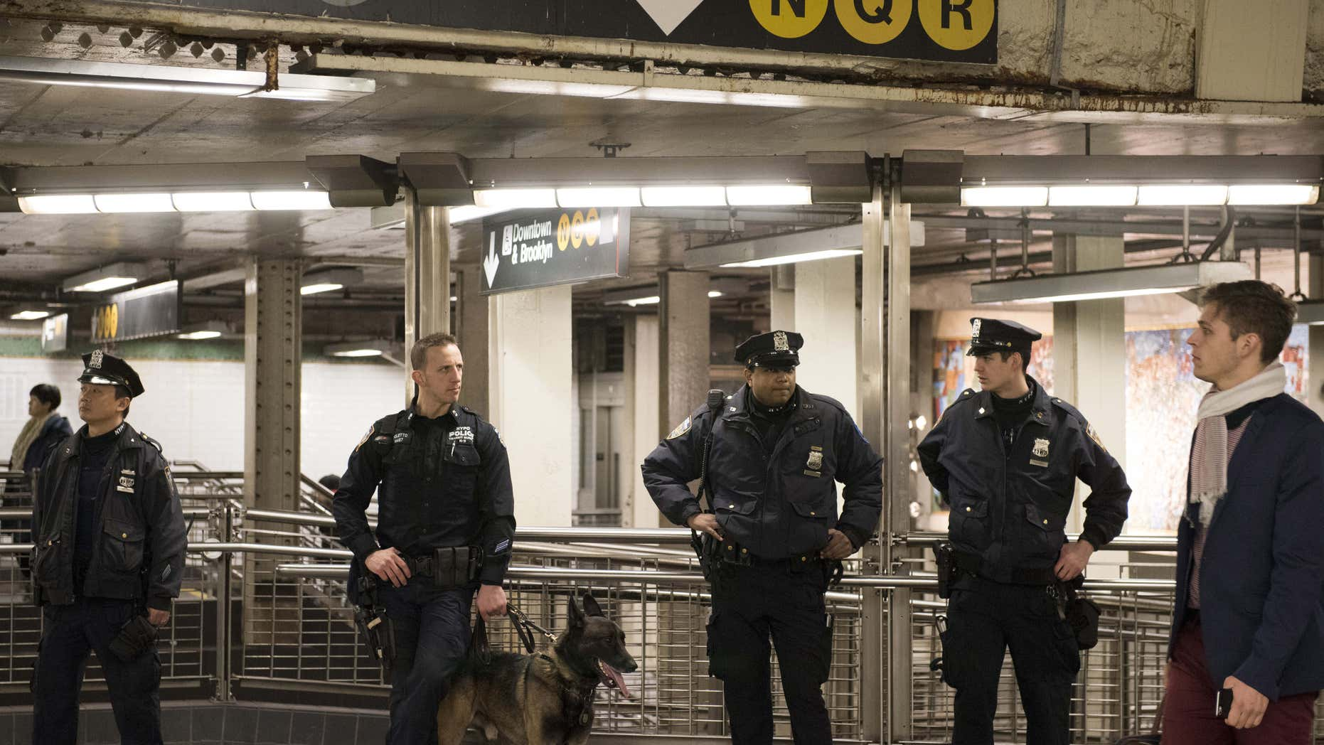 Dec. 31, 2015: New York Police Department officers stand guard inside the Times Square subway station ahead of New Year's Eve celebrations in New York.