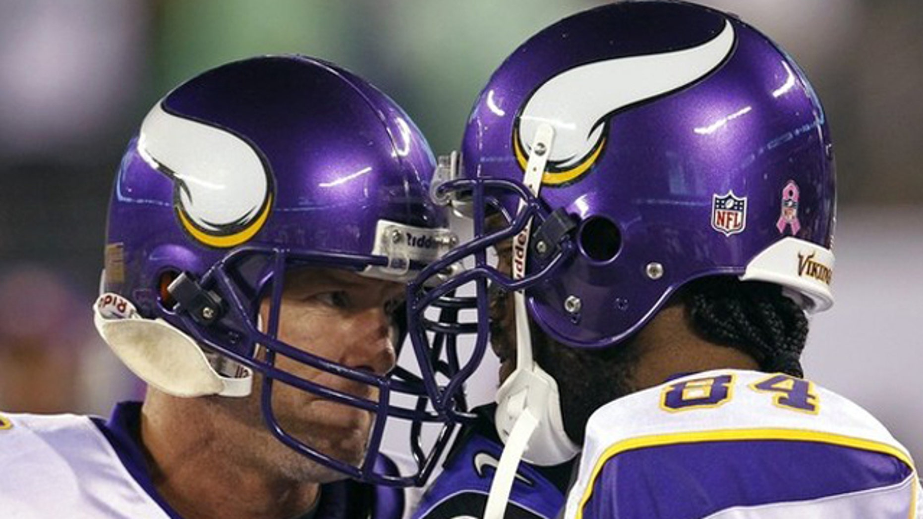 Oct. 11: Minnesota Viking wide receiver Randy Moss (R) and quarterback Brett Favre butt heads together on the bench before their NFL football game against the New York Jets in East Rutherford, New Jersey.