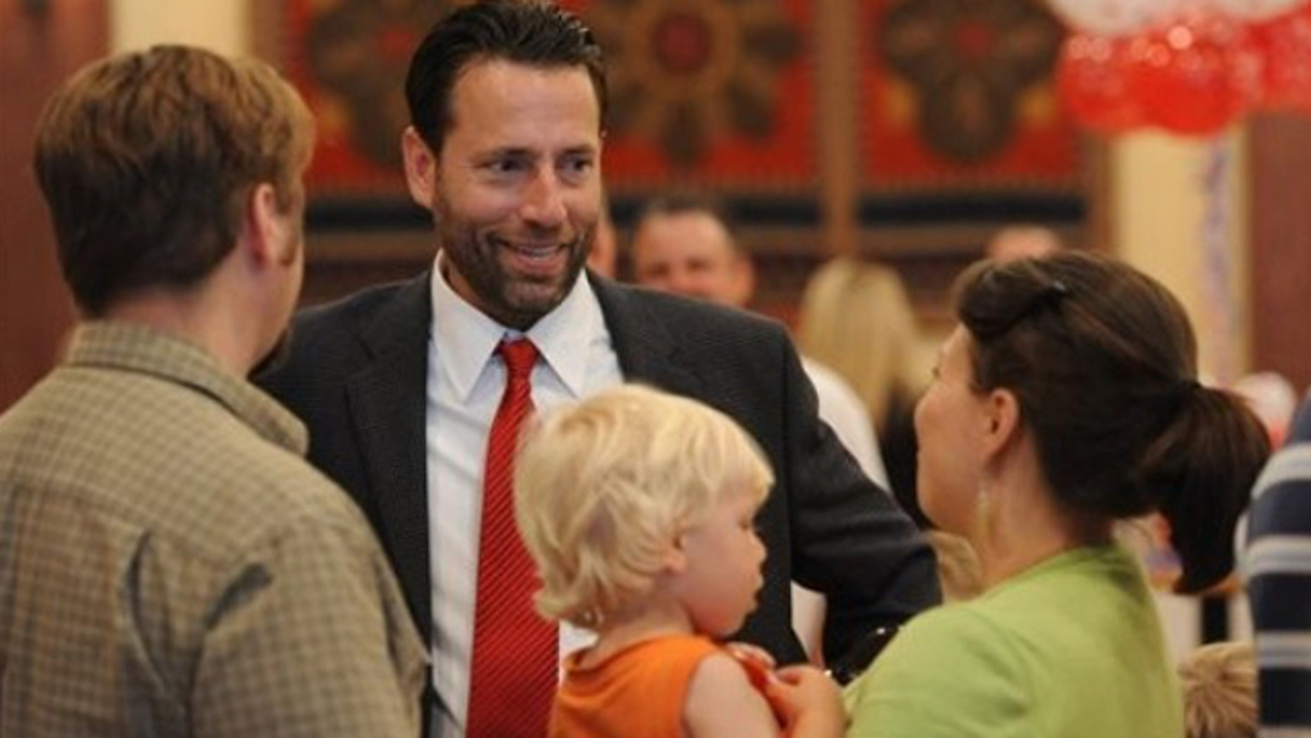 Aug. 24: Republican candidate for U.S. Senate  Joe Miller, center, smiles as he visits with supporters in Anchorage, Alaska.