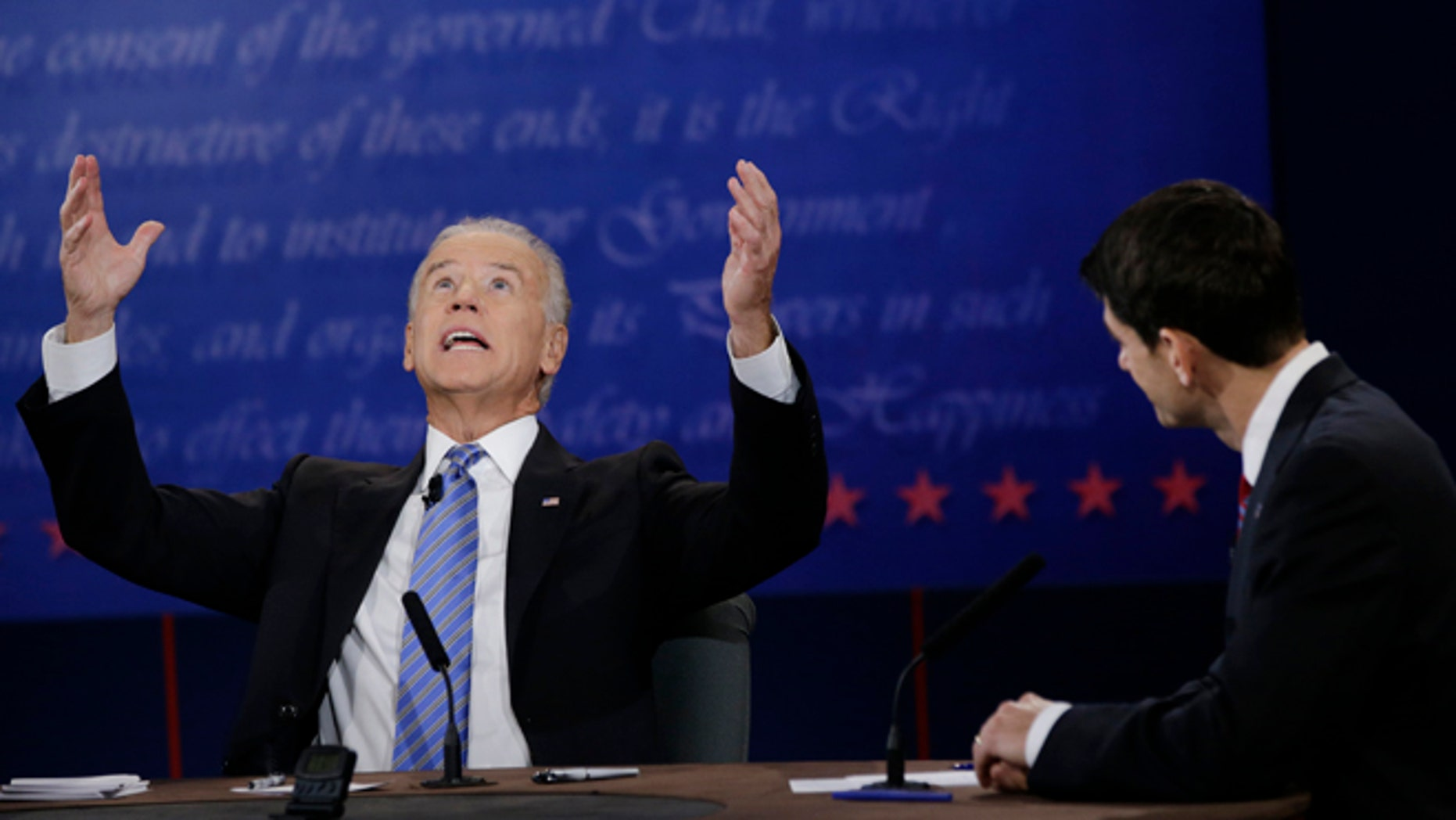 Oct. 11, 2012: Republican vice presidential nominee Rep. Paul Ryan, of Wisconsin, right, watches as Vice President Joe Biden, speaks during the vice presidential debate at Centre College in Danville, Ky.