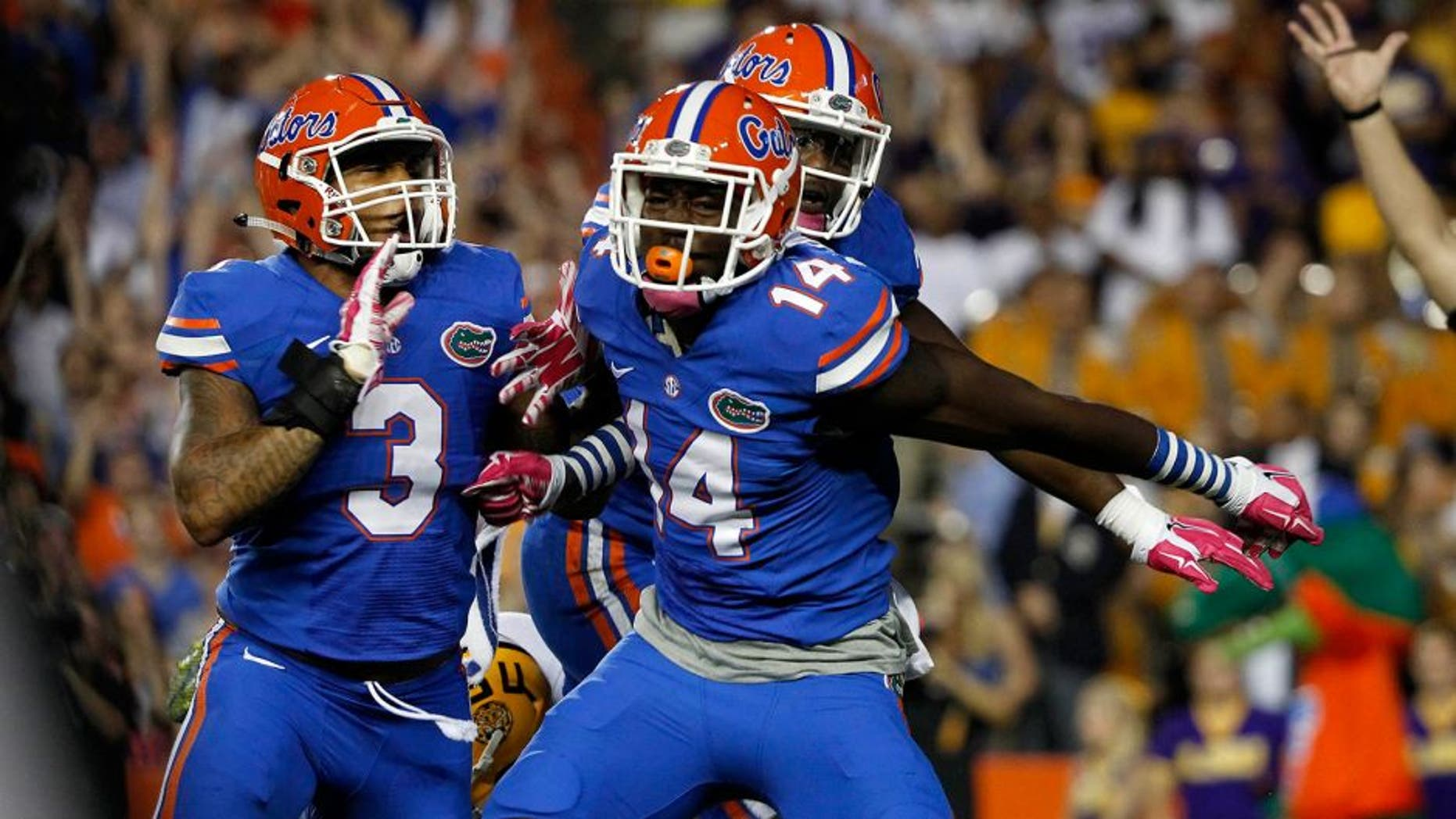 Oct 11, 2014; Gainesville, FL, USA; Florida Gators defensive lineman Alex McCalister (14) reacts after he sacks LSU Tigers quarterback Anthony Jennings (10) during the first quarter at Ben Hill Griffin Stadium. Mandatory Credit: Kim Klement-USA TODAY Sports