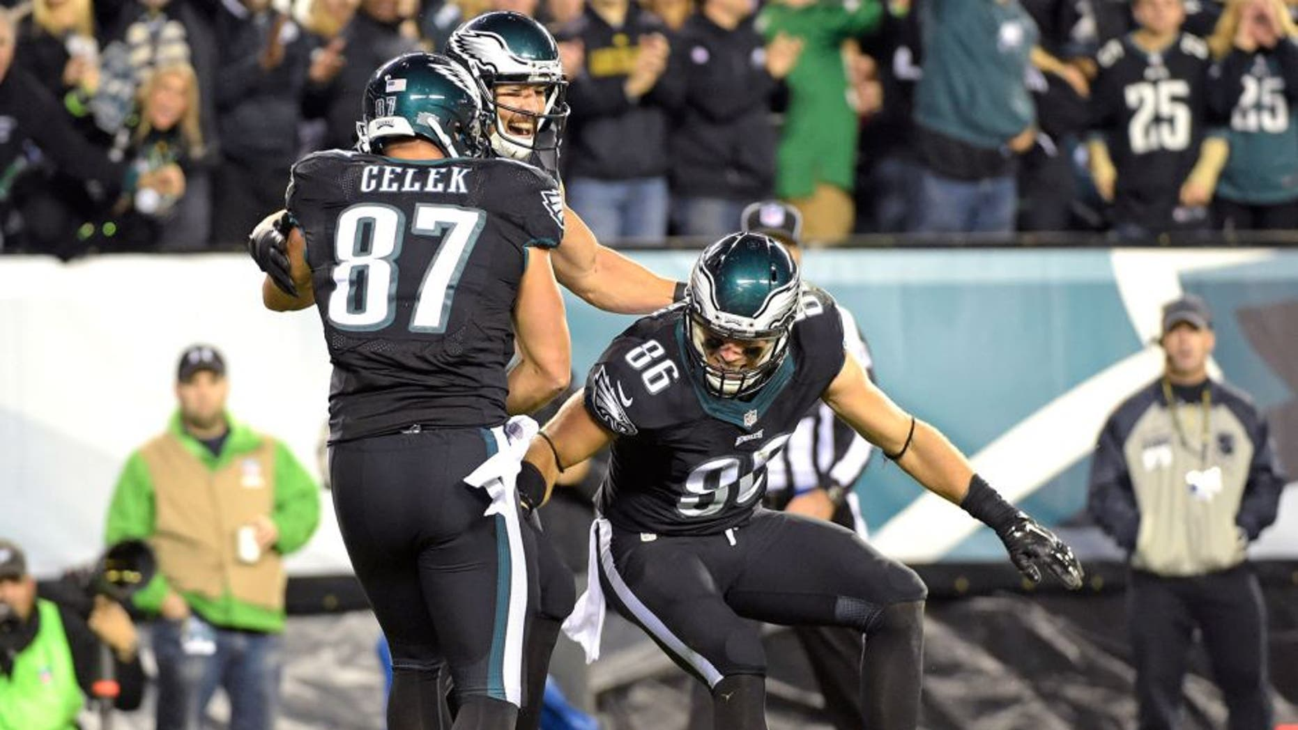 Oct 12, 2014; Philadelphia, PA, USA; Philadelphia Eagles tight end James Casey (85) celebrates his 26-yard touchdown catch with tight end Zach Ertz (86) and tight end Brent Celek (87) against the New York Giants during the second quarter at Lincoln Financial Field. Mandatory Credit: Eric Hartline-USA TODAY Sports
