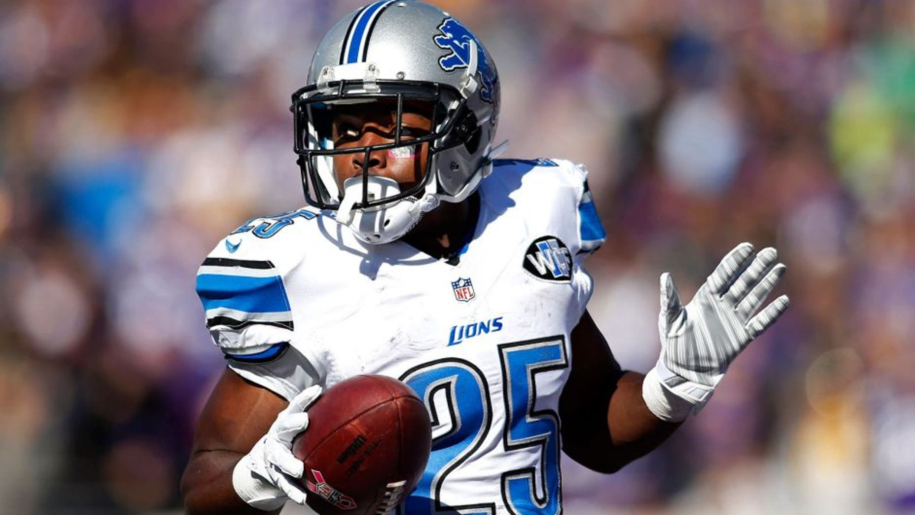 Oct 12, 2014; Minneapolis, MN, USA; Detroit Lions running back Theo Riddick (25) celebrates his touchdown against the Minnesota Vikings in the first quarter at TCF Bank Stadium. Mandatory Credit: Bruce Kluckhohn-USA TODAY Sports