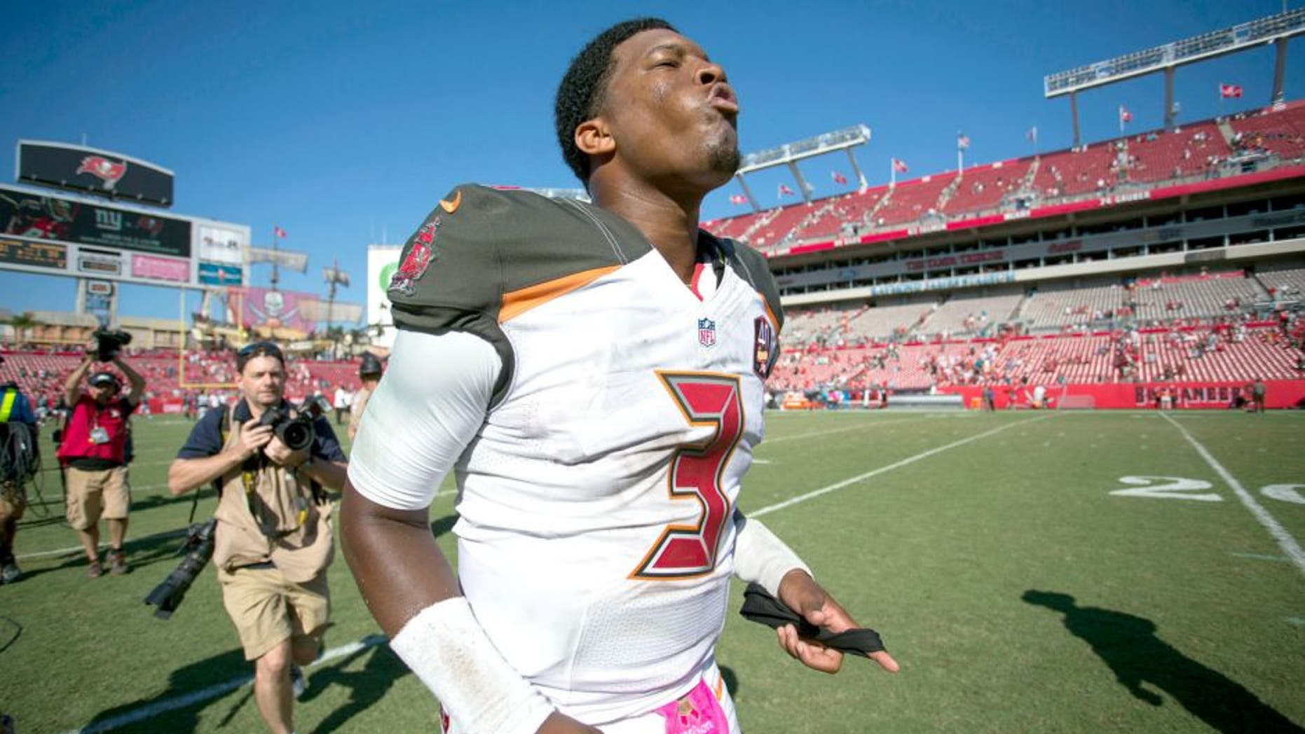 Oct 11, 2015; Tampa, FL, USA; Tampa Bay Buccaneers quarterback Jameis Winston (3) runs off the field at the end of the game against the Jacksonville Jaguars at Raymond James Stadium. The Tampa Bay Buccaneers won 38-31. Mandatory Credit: Logan Bowles-USA TODAY Sports