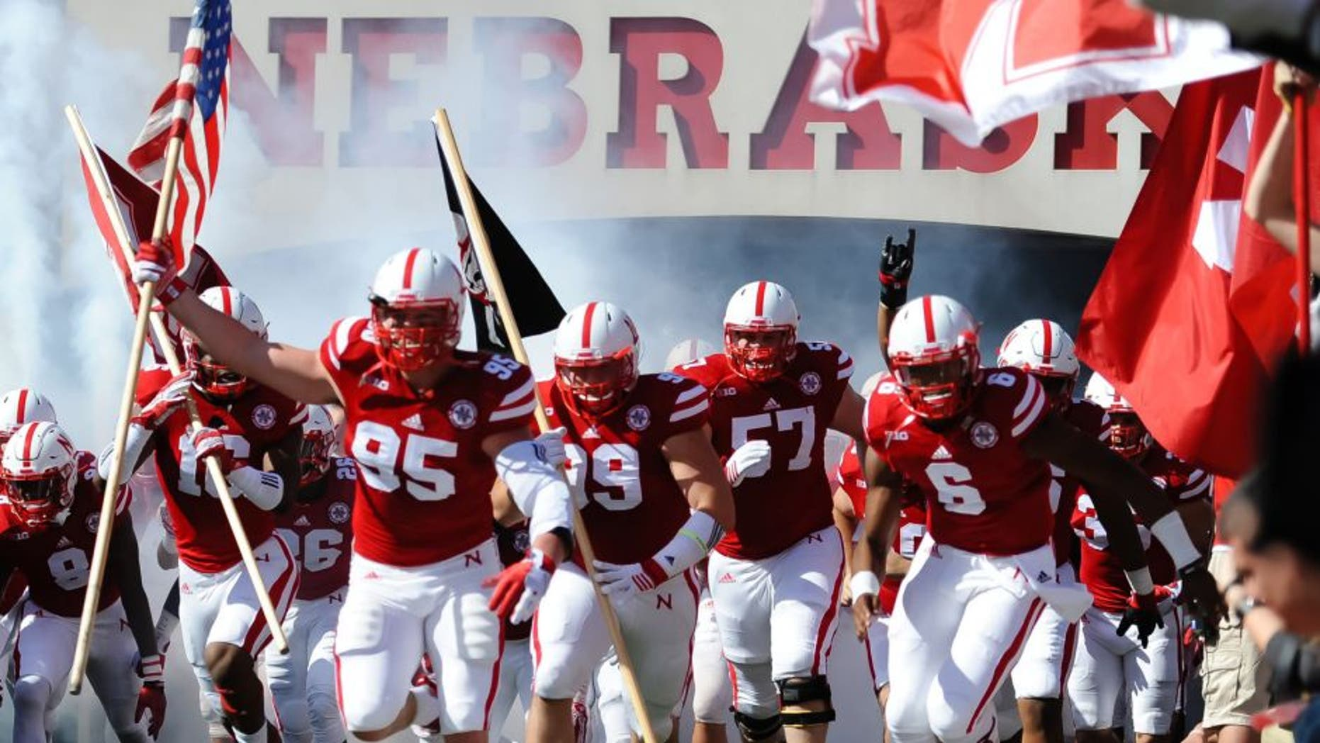 Oct 10, 2015; Lincoln, NE, USA; Nebraska Cornhuskers defensive end Jack Gangwish (95) leads the team on the field against the Wisconsin Badgers at Memorial Stadium. Mandatory Credit: Steven Branscombe-USA TODAY Sports