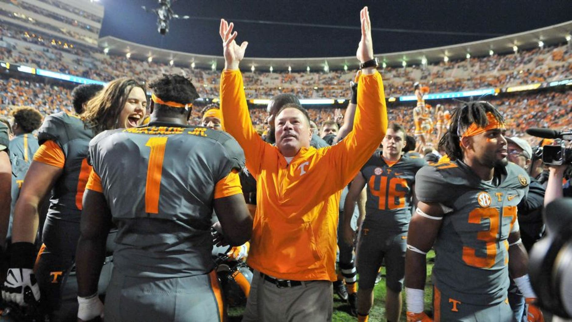 Oct 10, 2015; Knoxville, TN, USA; Tennessee Volunteers head coach Butch Jones waves to fans after his team defeated the Georgia Bulldogs during the second half at Neyland Stadium. Tennessee won 38-31. Mandatory Credit: Jim Brown-USA TODAY Sports