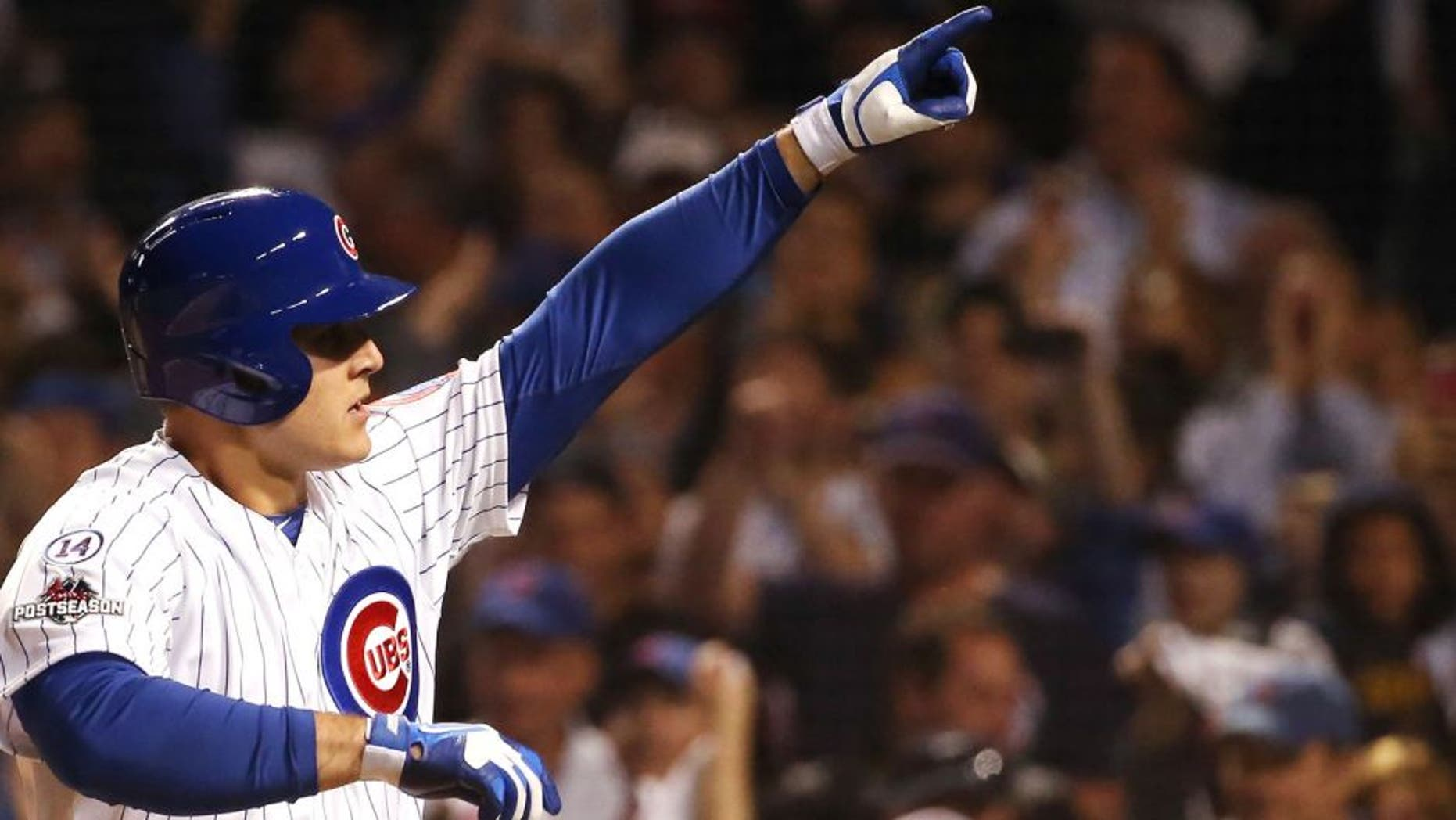 CHICAGO, IL - OCTOBER 12: Anthony Rizzo #44 of the Chicago Cubs reacts after hitting a solo home run in the fifth inning against the St. Louis Cardinals during game three of the National League Division Series at Wrigley Field on October 12, 2015 in Chicago, Illinois. (Photo by Jonathan Daniel/Getty Images)