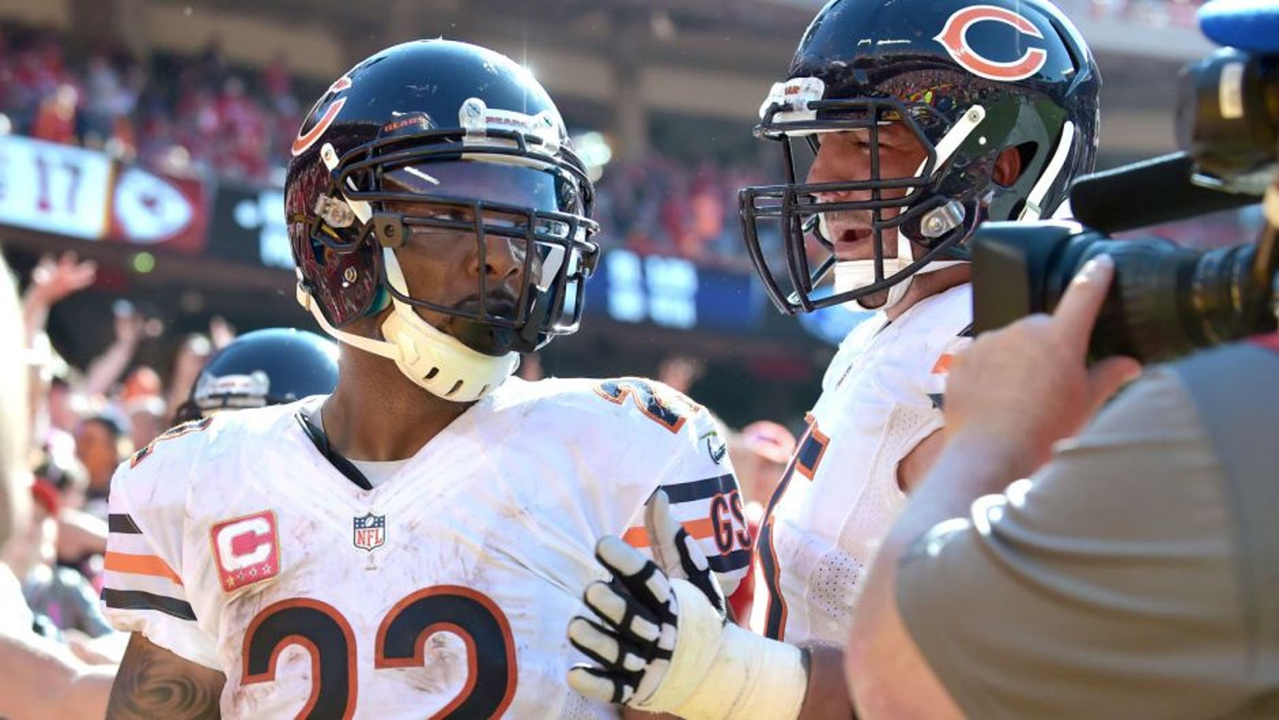 Oct 11, 2015; Kansas City, MO, USA; Chicago Bears running back Matt Forte (22) is congratulated by tackle Charles Leno (72) after scoring the winning touchdown during the second half against the Kansas City Chiefs at Arrowhead Stadium. The Bears won 18-17. Mandatory Credit: Denny Medley-USA TODAY Sports
