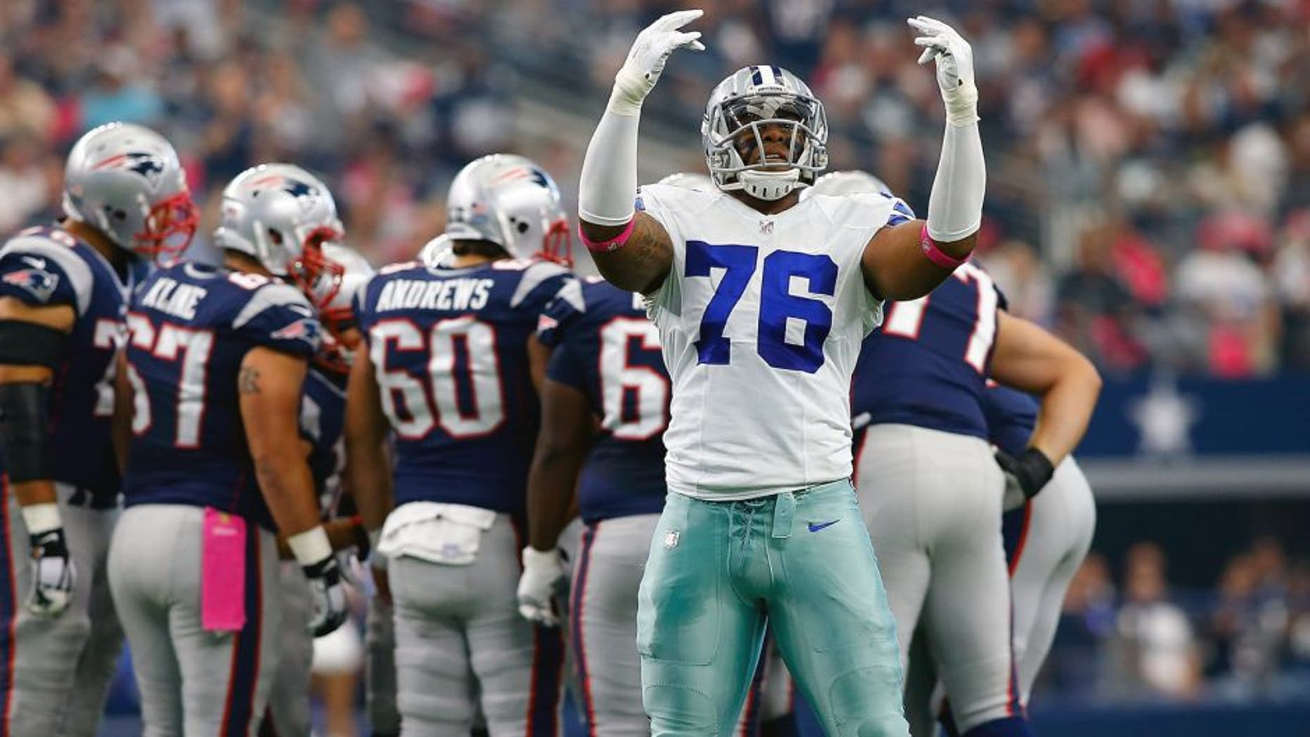 ARLINGTON, TX - OCTOBER 11: Greg Hardy #76 of the Dallas Cowboys encourages the crowd to make noise during the first half of the NFL game against the New England Patriots at AT&T Stadium on October 11, 2015 in Arlington, Texas. (Photo by Mike Stone/Getty Images)