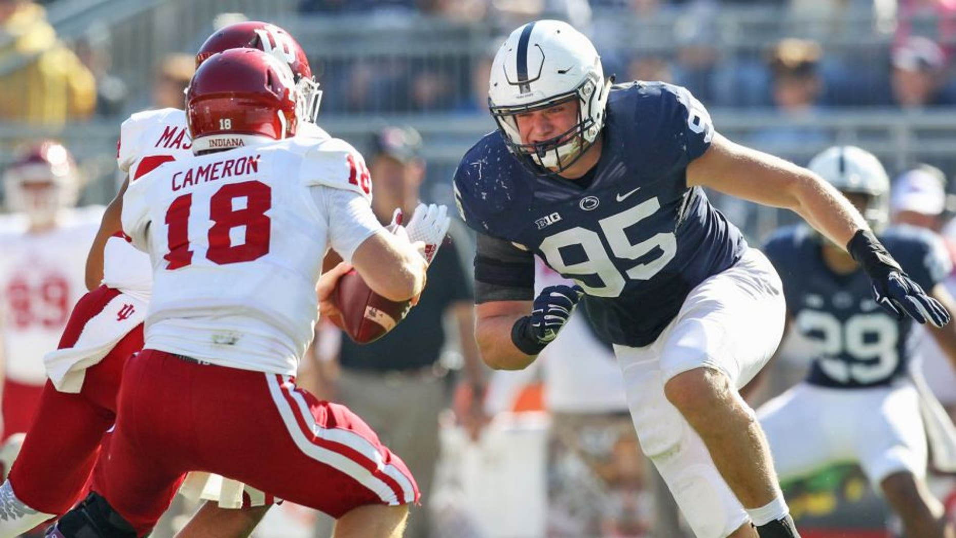 Oct 10, 2015; University Park, PA, USA; Penn State Nittany Lions defensive end Carl Nassib (95) pressures Indiana Hoosiers quarterback Danny Cameron (18) during the fourth quarter at Beaver Stadium. Penn State defeated Indiana 29-7. Mandatory Credit: Matthew O'Haren-USA TODAY Sports