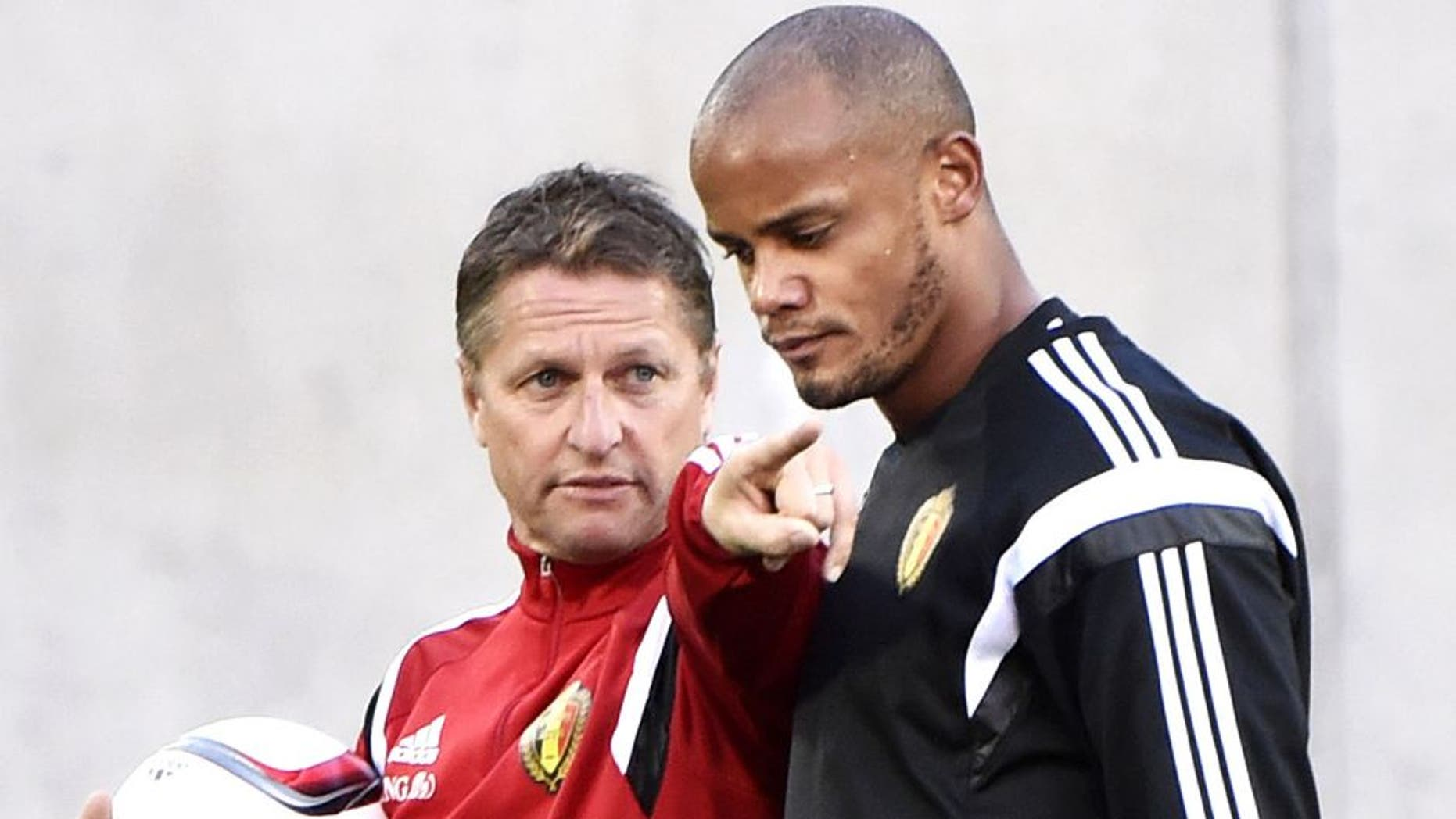 Belgium's Coach Marc Wilmots (L) and defender Vincent Kompany attend a training session at the Estadi Comunal in Andorra la Vella on October 10, 2015, on the eve of the Euro2016 qualifying group D football match Andorra against Belgium. AFP PHOTO / PASCAL PAVANI (Photo credit should read PASCAL PAVANI/AFP/Getty Images)