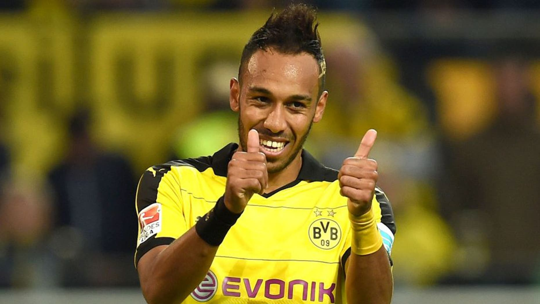 Dortmund's Gabonese striker Pierre-Emerick Aubameyang reacts during the German first division Bundesliga football match Borussia Dortmund v SV Darmstadt 98, in Dortmund, western Germany, on September 27, 2015. The match ended with a 2-2 draw. AFP PHOTO / PATRIK STOLLARZ RESTRICTIONS: DURING MATCH TIME: DFL RULES TO LIMIT THE ONLINE USAGE TO 15 PICTURES PER MATCH AND FORBID IMAGE SEQUENCES TO SIMULATE VIDEO. == RESTRICTED TO EDITORIAL USE == FOR FURTHER QUERIES PLEASE CONTACT DFL DIRECTLY AT + 49 69 650050. (Photo credit should read PATRIK STOLLARZ/AFP/Getty Images)