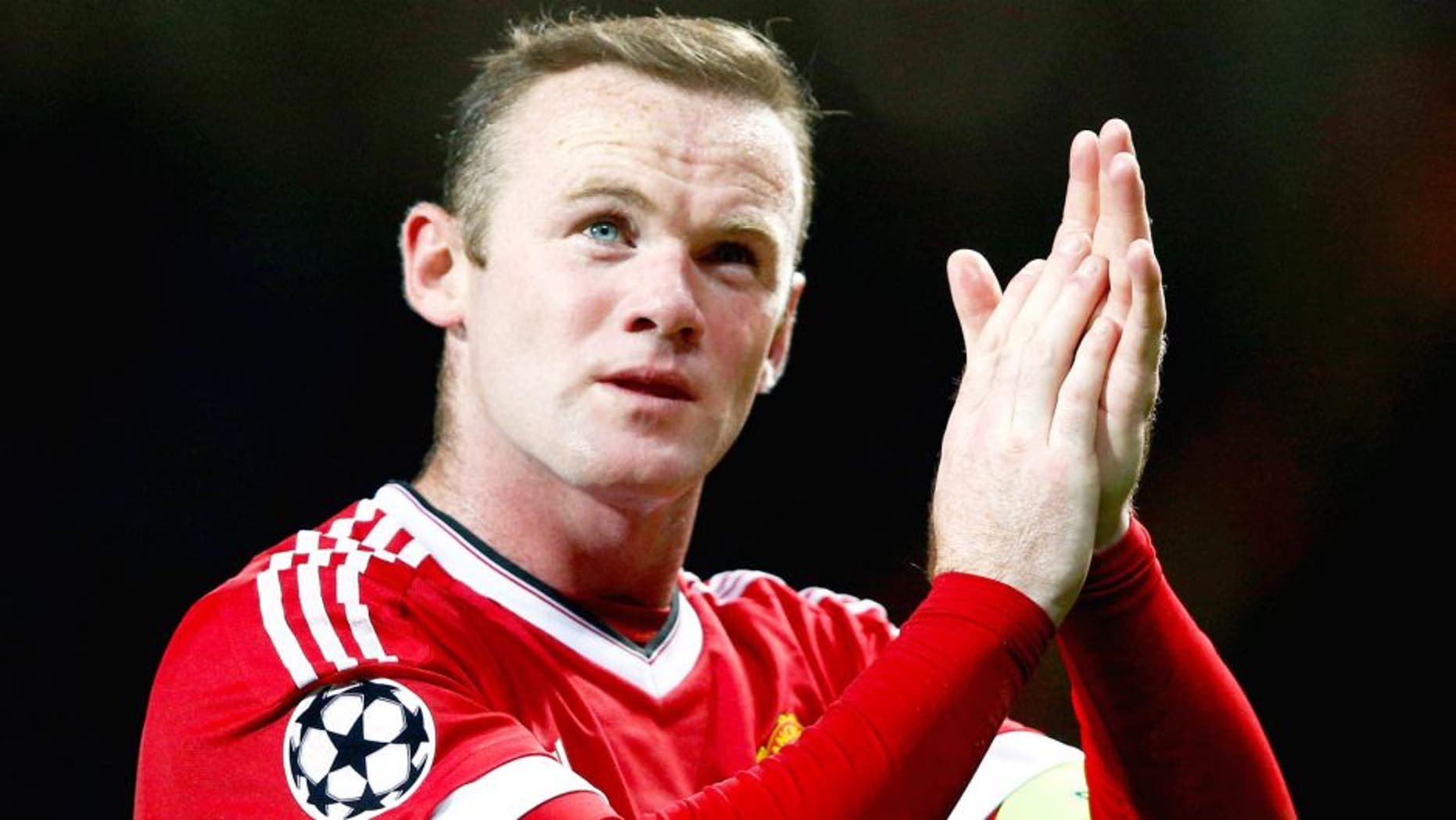 MANCHESTER, ENGLAND - SEPTEMBER 30: Wayne Rooney of Manchester United applauds the crowd after victory in the UEFA Champions League Group B match between Manchester United FC and VfL Wolfsburg at Old Trafford on September 30, 2015 in Manchester, United Kingdom. (Photo by Dean Mouhtaropoulos/Getty Images)