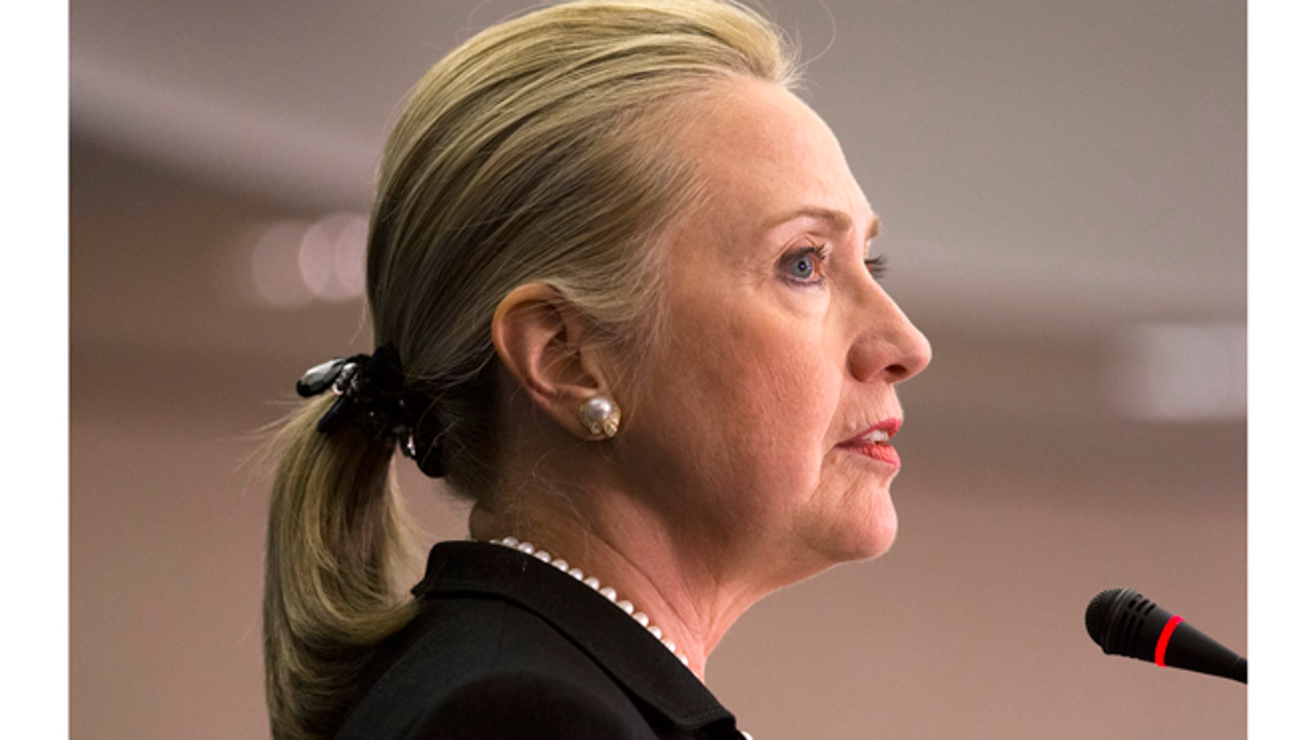 Secretary of State Hillary Rodham Clinton says the United States must continue sending diplomats and aid workers to the Arab world's emerging democracies, despite last month's deadly attack in Libya, during a speech at the Center for Strategic and International Studies in Washington, Friday, Oct. 12, 2012. (AP Photo/J. Scott Applewhite)