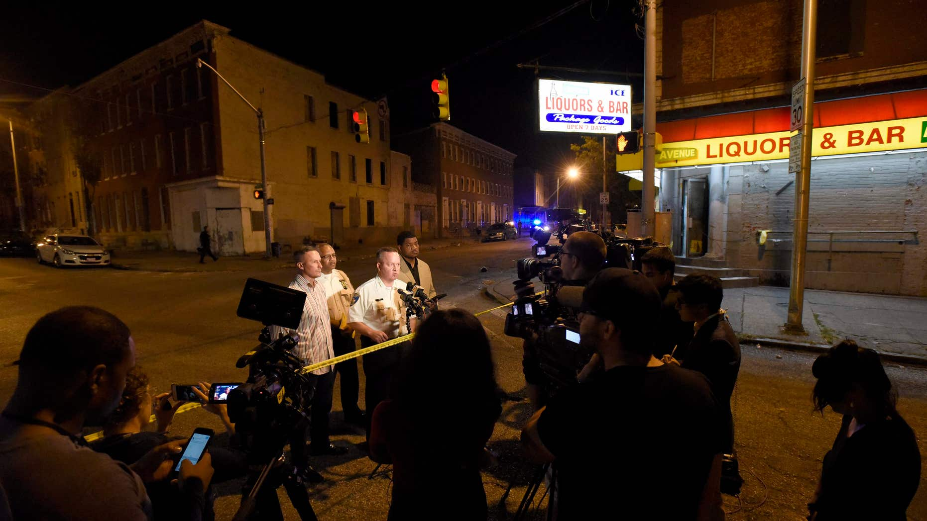 Sept. 24, 2016: Baltimore police, from left, Deputy Commissioner Dean Palmere, Stanley Brandford, chief of detectives, Commissioner Kevin Davis and T.J. Smith, police spokesman, speak to reporters at a scene where multiple people were shot and wounded in Baltimore.