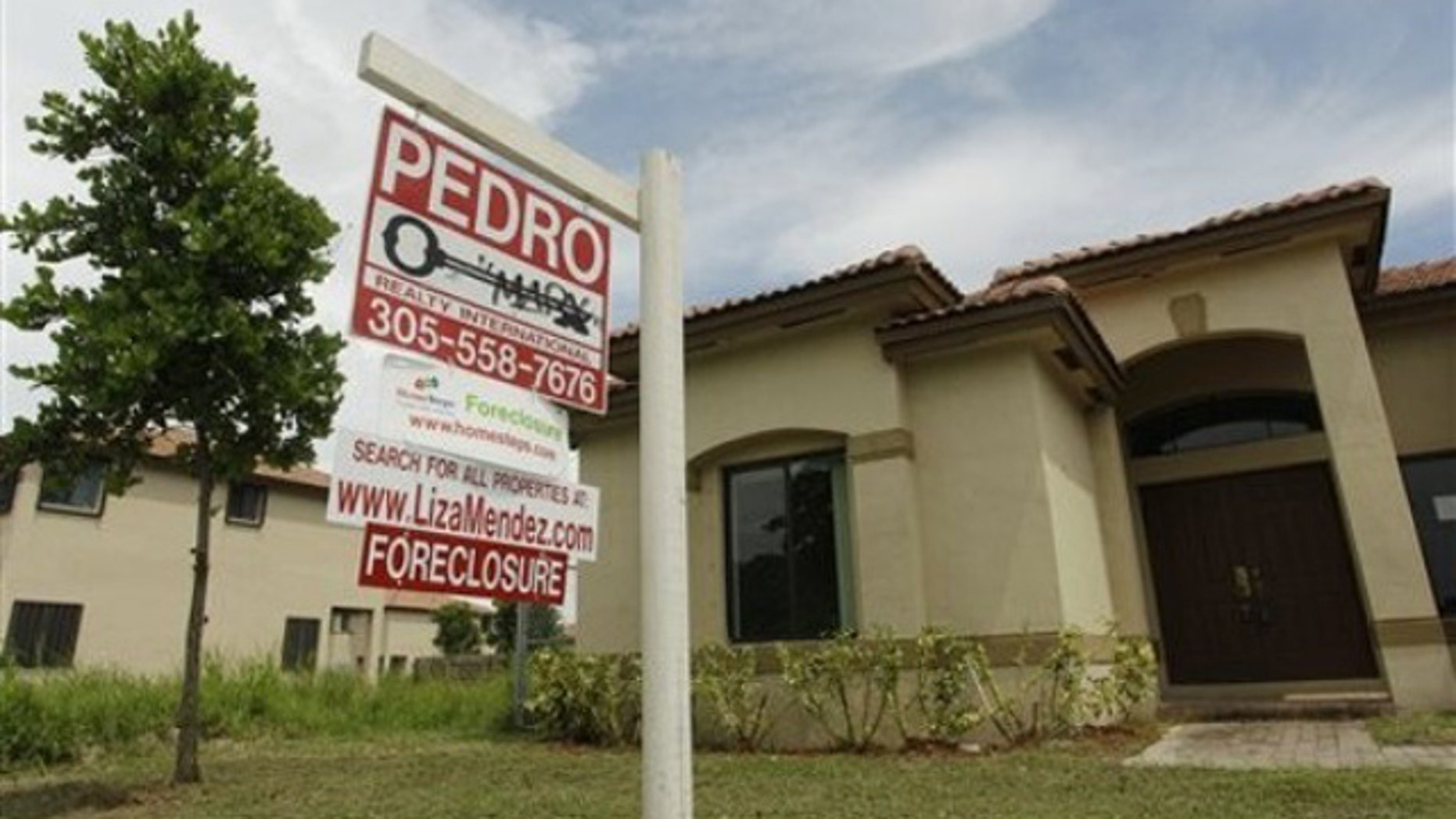 Sept. 14: A foreclosed home sits empty in a Homestead, Fla., neighborhood where half of the houses are empty and up for foreclosure.