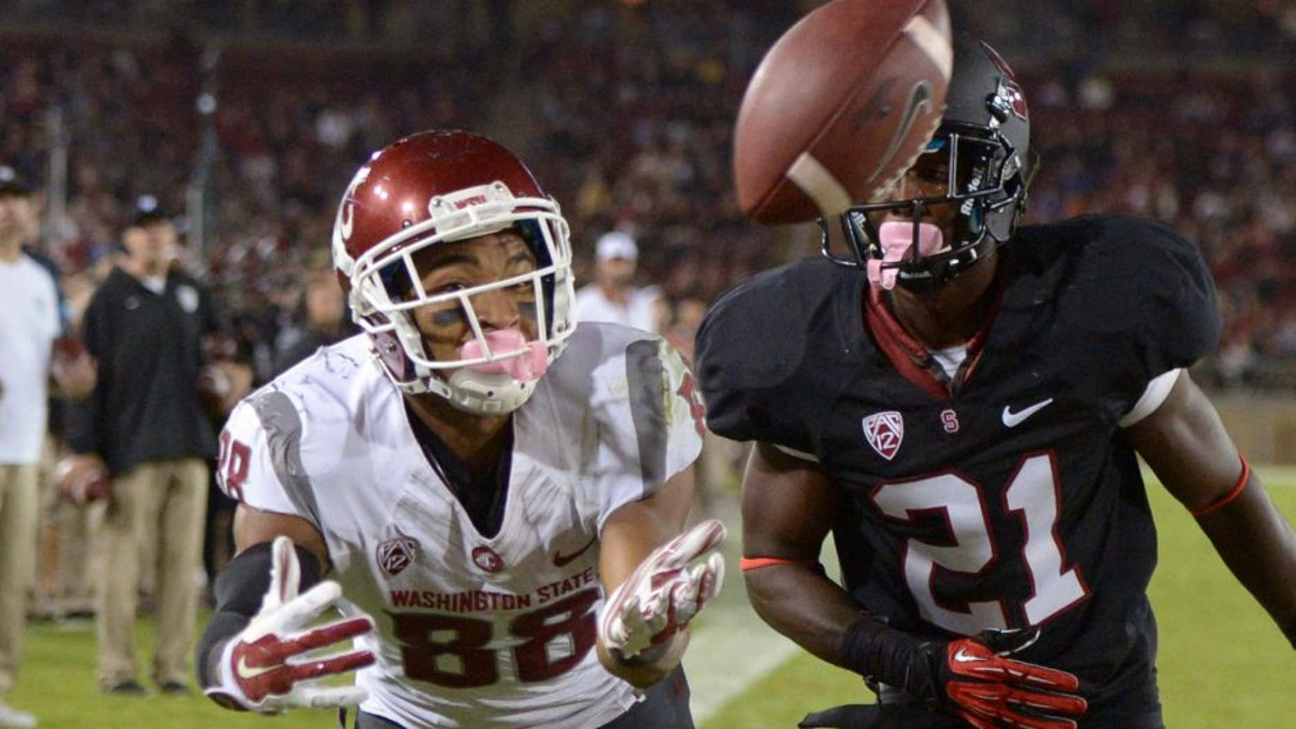Oct 10, 2014; Stanford, CA, USA; Washington State Cougars receiver Isiah Myers (88) is defended by Stanford Cardinal cornerback Ronnie Harris (21) at Stanford Stadium. Stanford defeated Washington State 34-17. Mandatory Credit: Kirby Lee-USA TODAY Sports