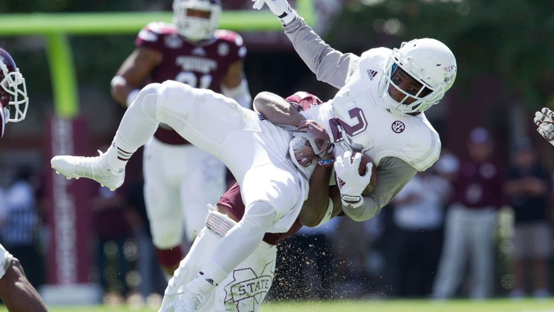 Oct 4, 2014; Starkville, MS, USA; Texas A&M Aggies wide receiver Speedy Noil (2) is grabbed by Mississippi State Bulldogs defensive back Taveze Calhoun (23) at Davis Wade Stadium. Mandatory Credit: Marvin Gentry-USA TODAY Sports