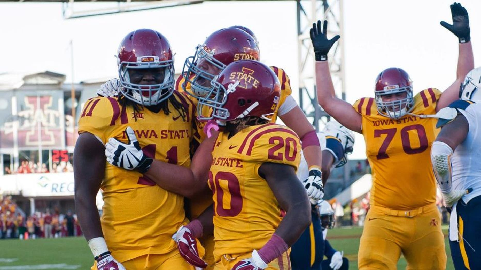 Oct 11, 2014; Ames, IA, USA; Iowa State Cyclones tight end E.J. Bibbs (11) celebrates with running back DeVondrick Nealy (20) and offensive lineman Daniel Burton (70) after scoring against the Toledo Rockets at Jack Trice Stadium. Iowa State defeated Toledo 37-30. Mandatory Credit: Steven Branscombe-USA TODAY Sports