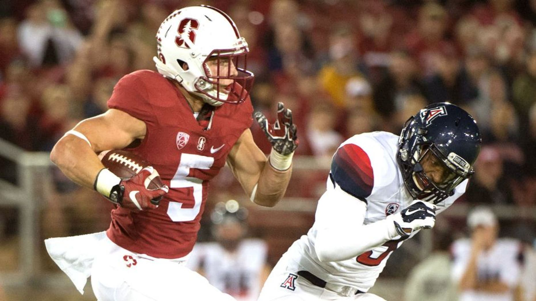 October 3, 2015; Stanford, CA, USA; Stanford Cardinal running back Christian McCaffrey (5) runs the football against Arizona Wildcats cornerback Cam Denson (3) during the first quarter at Stanford Stadium. Mandatory Credit: Kyle Terada-USA TODAY Sports