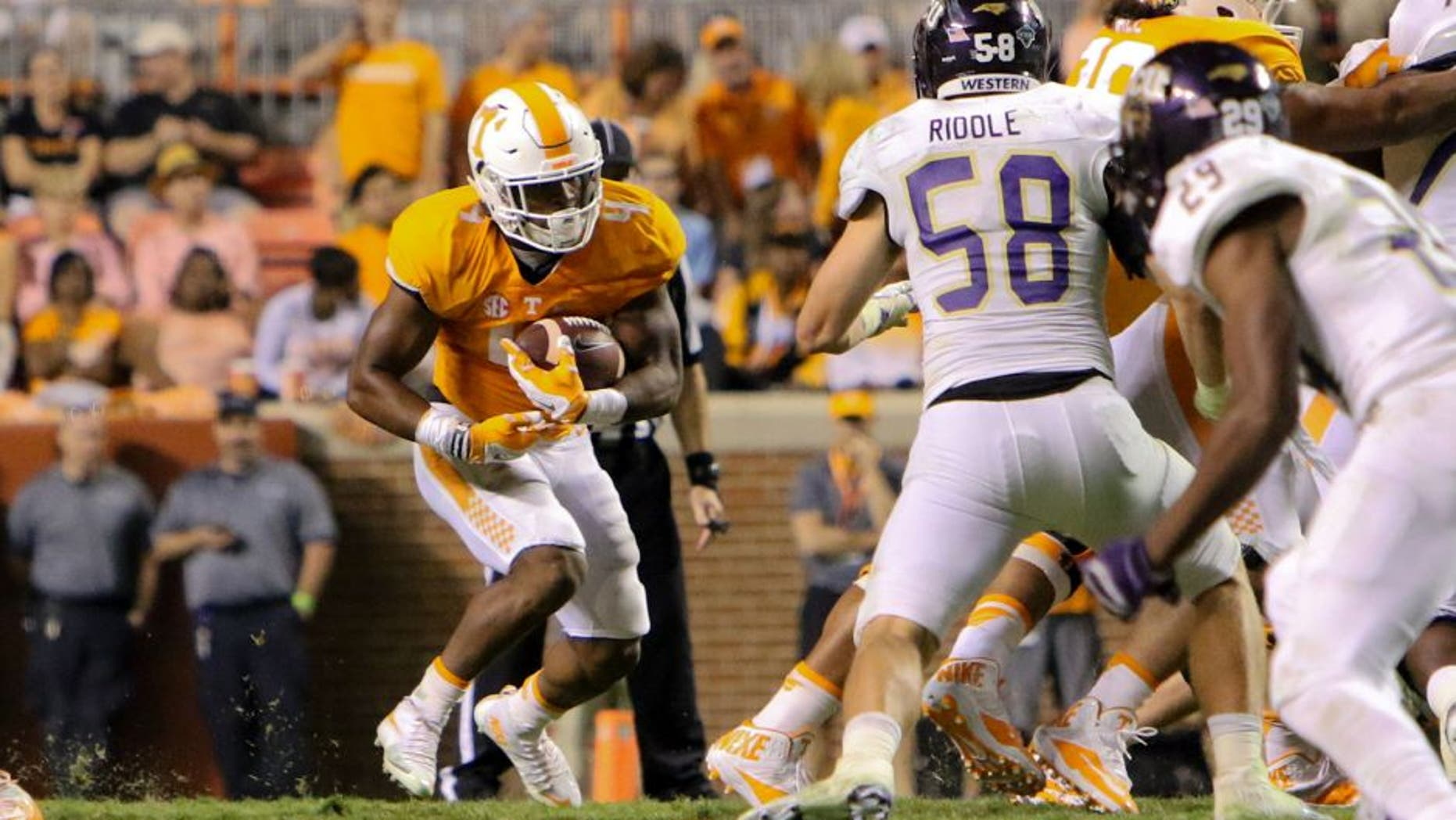 Sep 19, 2015; Knoxville, TN, USA; Tennessee Volunteers running back John Kelly (4) runs the ball during the second half against the Western Carolina Catamounts at Neyland Stadium. Tennessee won 55 to10. Mandatory Credit: Randy Sartin-USA TODAY Sports