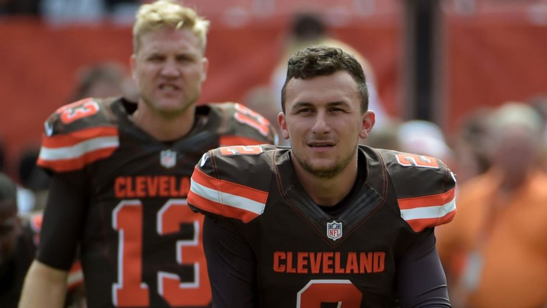 Sep 27, 2015; Cleveland, OH, USA; Cleveland Browns quarterbacks Johnny Manziel (2) and Josh McCown (13) stretch before a NFL game against the Oakland Raiders at FirstEnergy Stadium.