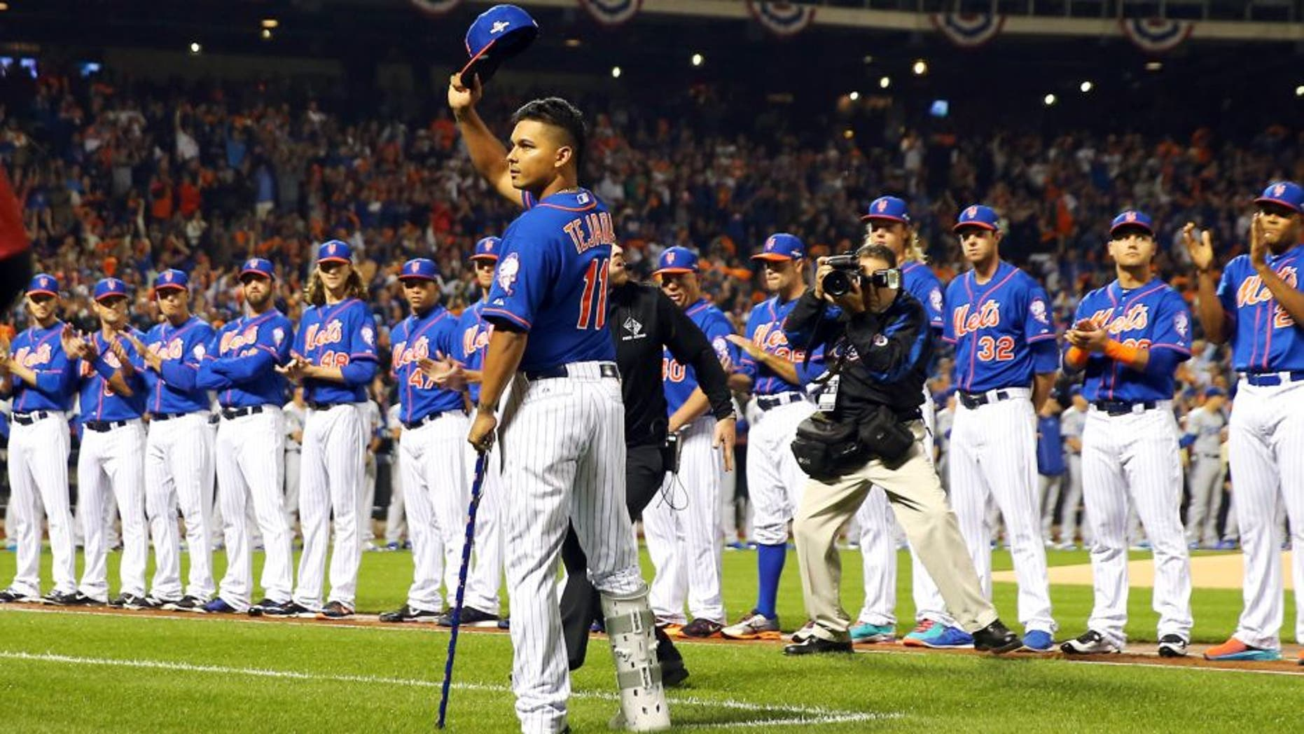 NEW YORK, NY - OCTOBER 12: An injured Ruben Tejada #11 of the New York Mets waves to the crowd prior to game three of the National League Division Series against the Los Angeles Dodgers at Citi Field on October 12, 2015 in New York City. (Photo by Elsa/Getty Images)