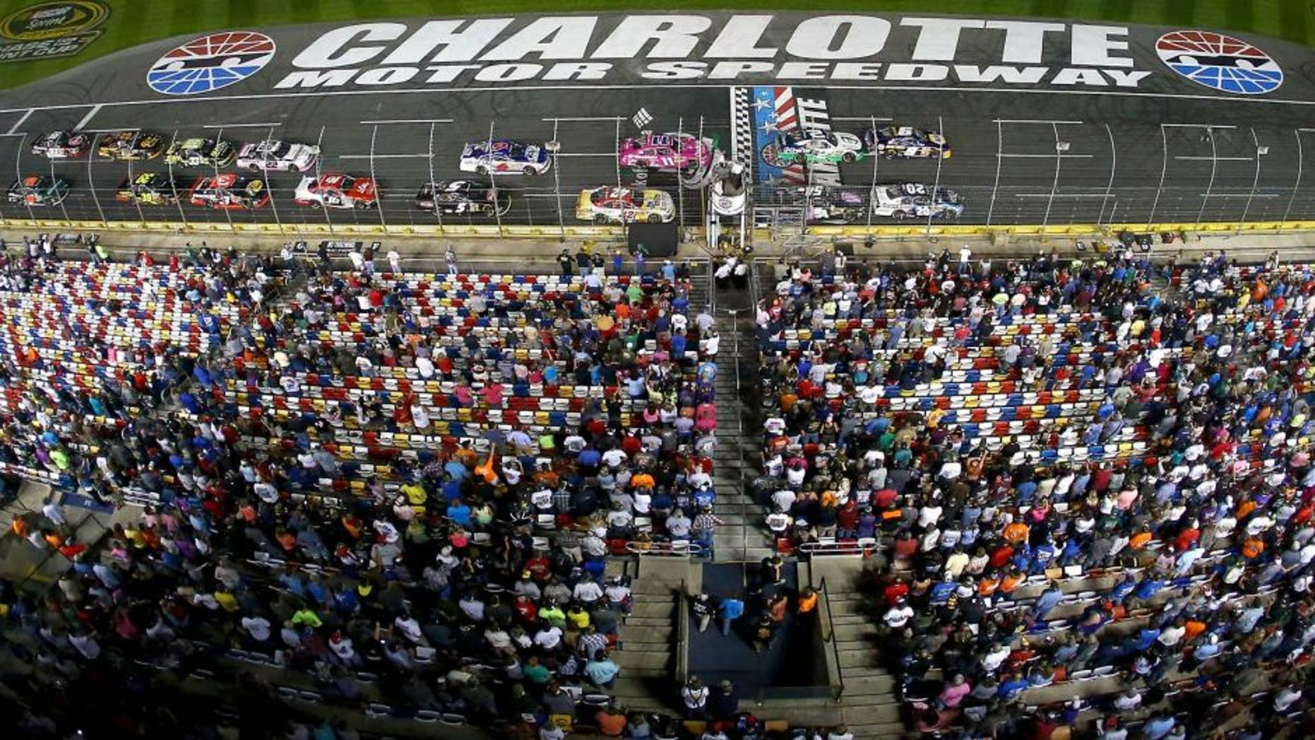 CHARLOTTE, NC - OCTOBER 10: A general view of cars racing during the NASCAR Nationwide Series Drive For The Cure 300 presented by Blue Cross Blue Shield of North Carolina at Charlotte Motor Speedway on October 10, 2014 in Charlotte, North Carolina. (Photo by Streeter Lecka/Getty Images)