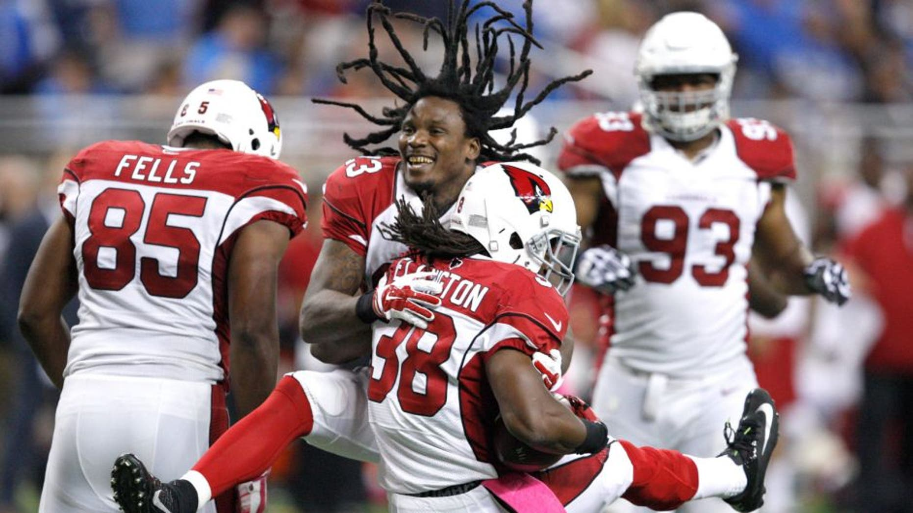 Oct 11, 2015; Detroit, MI, USA; Arizona Cardinals running back Andre Ellington (38) celebrates with running back Chris Johnson (23) after a touchdown during the fourth quarter against the Detroit Lions at Ford Field. Cardinals won 42-17. Mandatory Credit: Raj Mehta-USA TODAY Sports