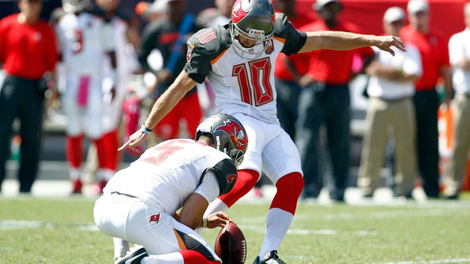 Oct 11, 2015; Tampa, FL, USA; Tampa Bay Buccaneers place kicker Connor Barth kicks his first field goal from the hold of punter Jacob Schum (5) after being re-signed by the Tampa Bay Buccaneers against the Jacksonville Jaguars during the first quarter of an NFL football game at Raymond James Stadium. Mandatory Credit: Reinhold Matay-USA TODAY Sports