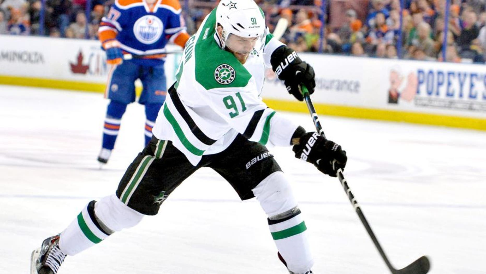 Mar 27, 2015; Edmonton, Alberta, CAN; Dallas Stars center Tyler Seguin (91) takes a slap shot against the Edmonton Oilers in the second period at Rexall Place. Mandatory Credit: Chris LaFrance-USA TODAY Sports
