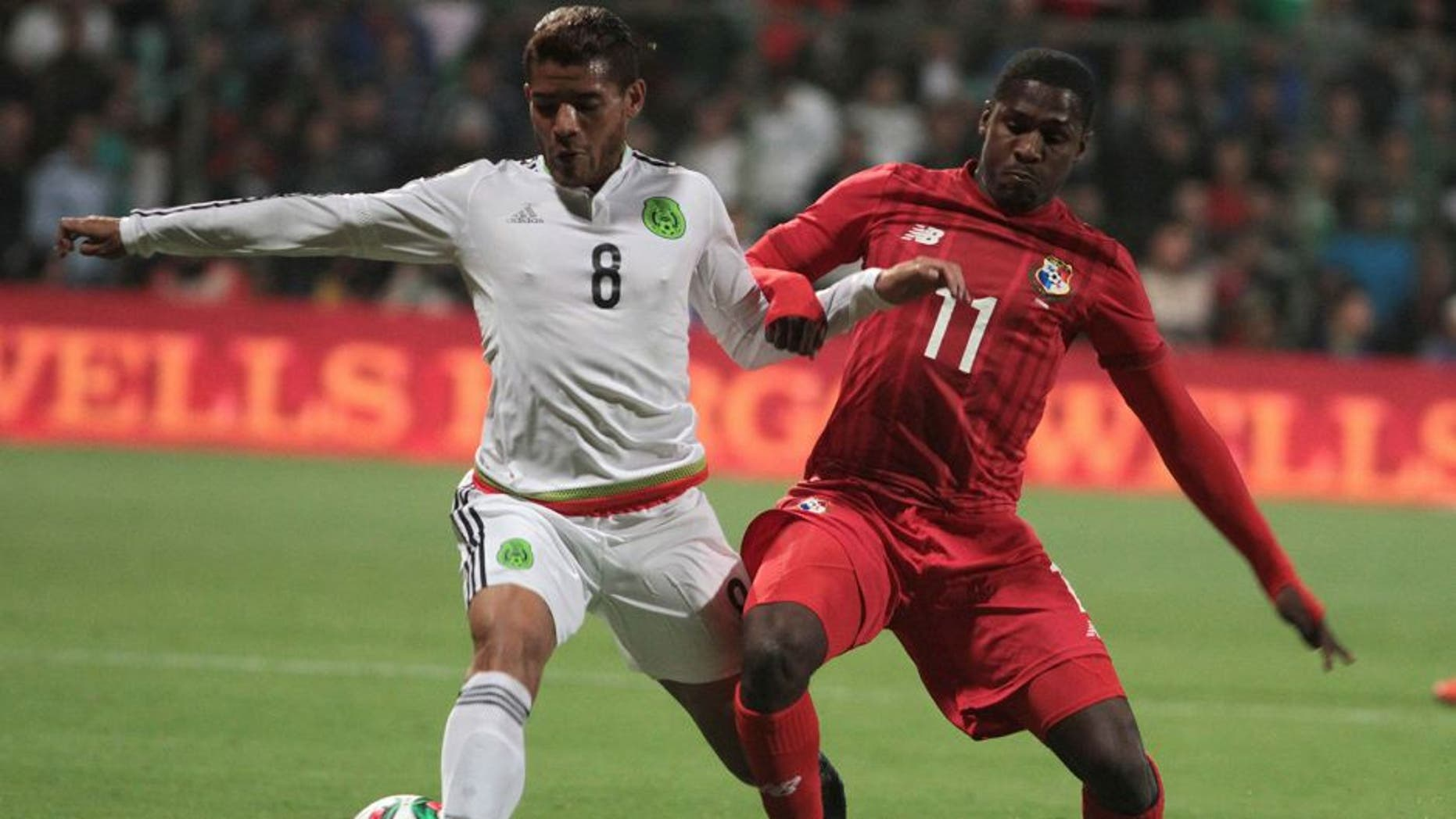 Jonathan Dos Santos (L) of Mexico vies for the ball with Armando Cooper (R) of Panama during their friendly match at the Nemesio Diez stadium on October 13, 2015, in Toluca ,Mexico. AFP PHOTO/MARIA CALLS (Photo credit should read MARIA CALLS/AFP/Getty Images)