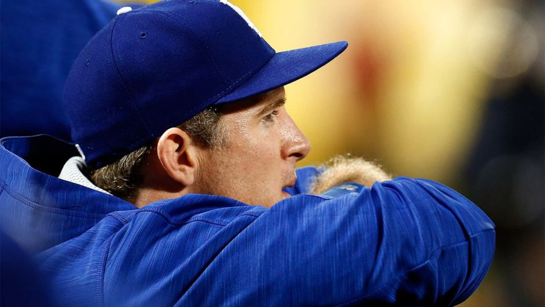NEW YORK, NY - OCTOBER 12: Chase Utley #26 of the Los Angeles Dodgers looks on from the dugout against the New York Mets during game three of the National League Division Series at Citi Field on October 12, 2015 in New York City. (Photo by Mike Stobe/Getty Images)