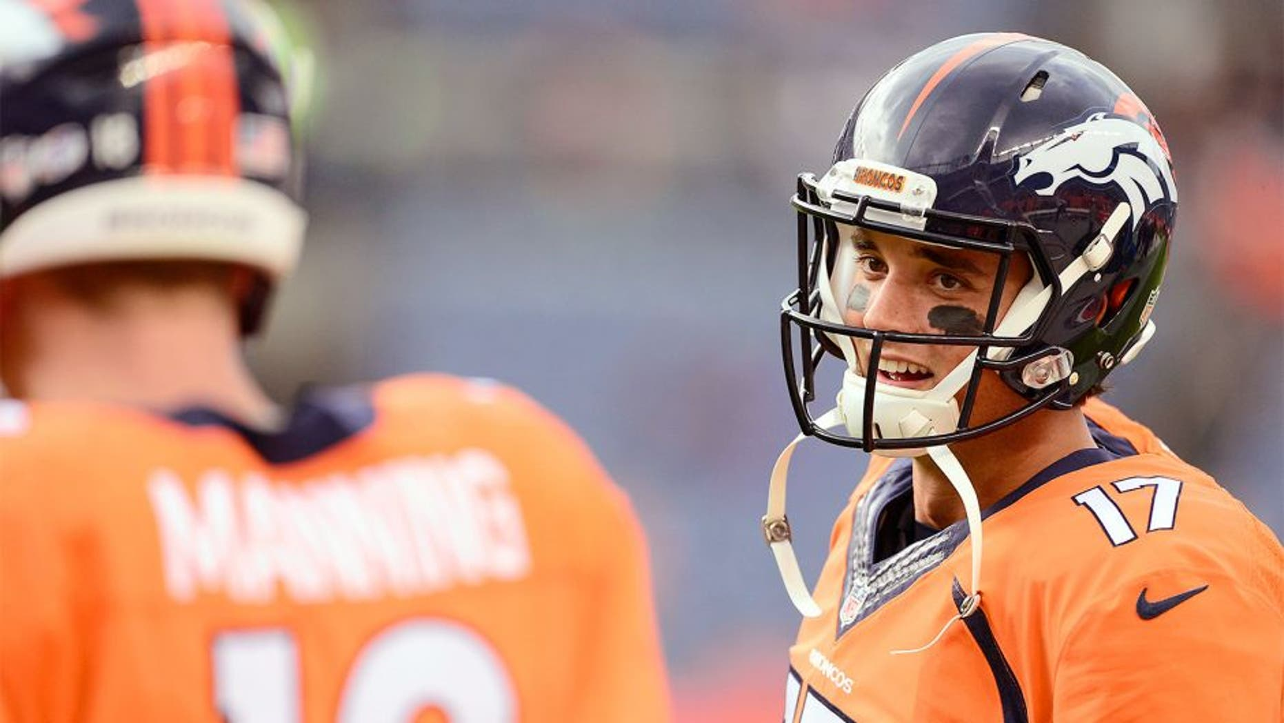 Sep 3, 2015; Denver, CO, USA; Denver Broncos quarterback Brock Osweiler (17) talks to quarterback Peyton Manning (18) before the preseason game against the Arizona Cardinals at Sports Authority Field at Mile High. Mandatory Credit: Ron Chenoy-USA TODAY Sports