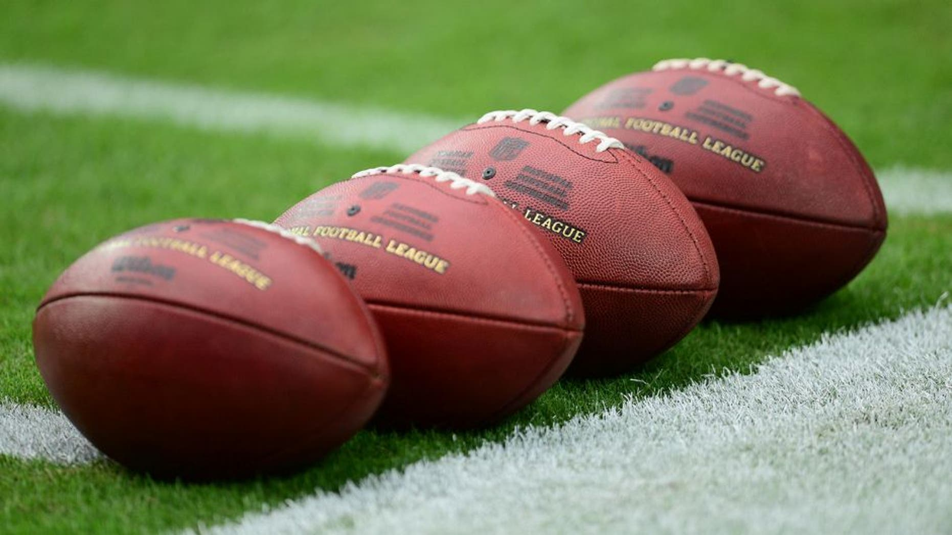 Sep 27, 2015; Glendale, AZ, USA; Footballs lie on the field prior to the game between the Arizona Cardinals and the San Francisco 49ers at University of Phoenix Stadium. Mandatory Credit: Joe Camporeale-USA TODAY Sports